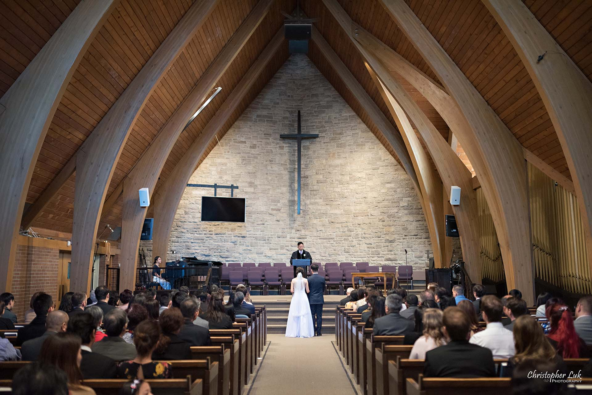 Christopher Luk Toronto Wedding Photographer - Natural Candid Photojournalistic Bride Groom Immanuel Baptist Church Ceremony Altar Front Wooden Beams Wide