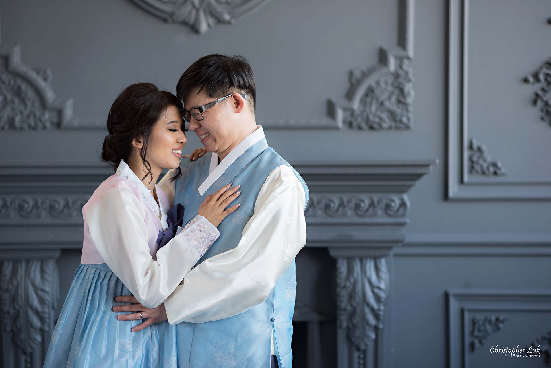 Christopher Luk Toronto Wedding Photographer - Mint Room Studios Bride Groom Natural Candid Photojournalistic Library Studio Korean Drama Hanbok Fireplace Hold Each Other Hug