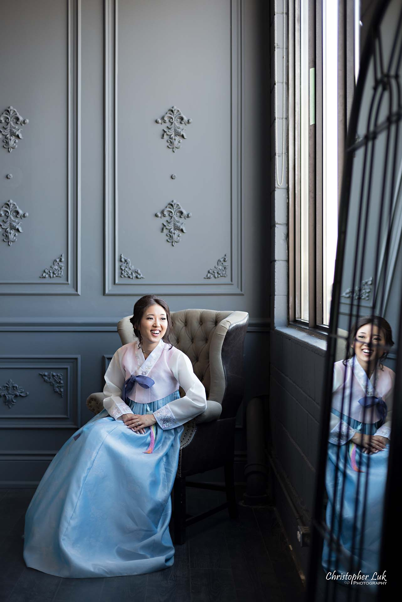 Christopher Luk Toronto Wedding Photographer - Mint Room Studios Bride Natural Candid Photojournalistic Library Studio Korean Drama Hanbok Leather Wingback Chair Mirror Vertical