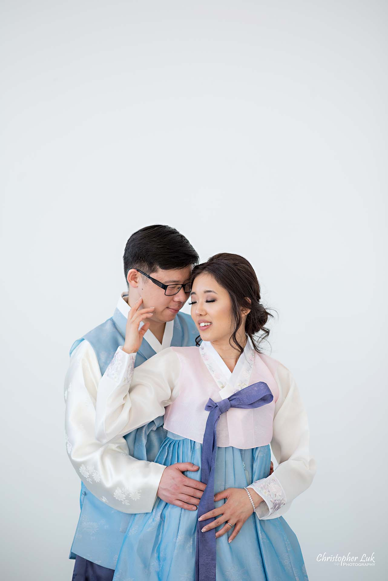 Christopher Luk Toronto Wedding Photographer - Mint Room Studios Bride Groom Natural Candid Photojournalistic Conservatory Ballroom Korean Drama Hanbok Hold Hug Each Other Intimate Close