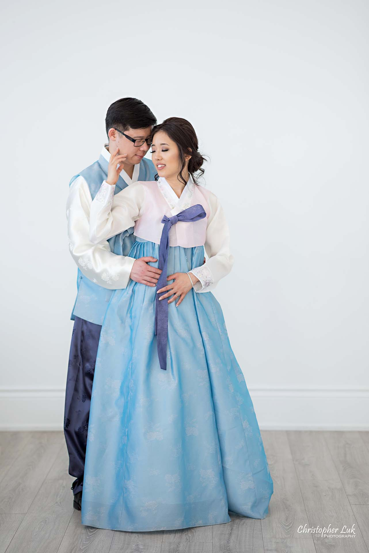 Christopher Luk Toronto Wedding Photographer - Mint Room Studios Bride Groom Natural Candid Photojournalistic Conservatory Ballroom Korean Hanbok Hold Hug Each Other Full Body