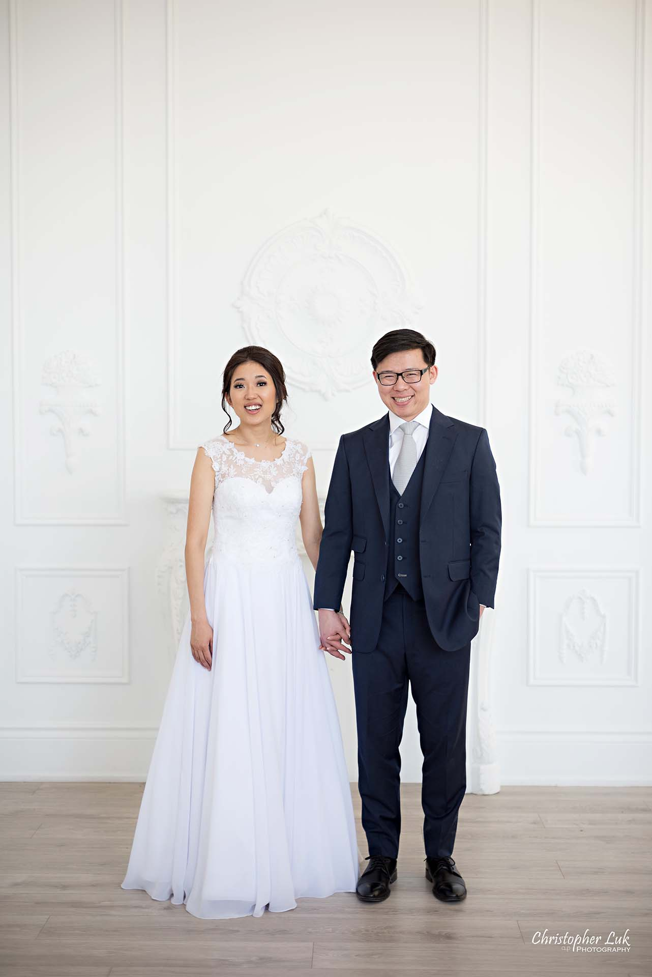 Christopher Luk Toronto Wedding Photographer - Mint Room Studios Bride Groom Natural Candid Photojournalistic Conservatory Ballroom Hug Laugh Full Body Fireplace Mantle