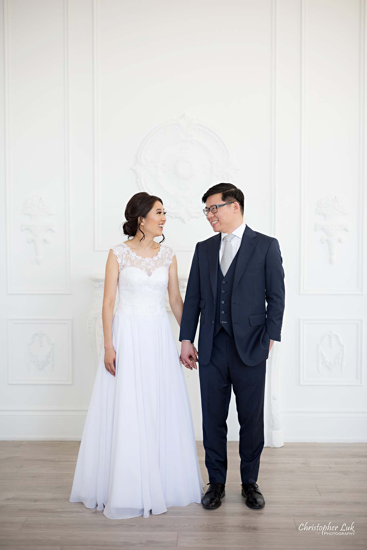Christopher Luk Toronto Wedding Photographer - Mint Room Studios Bride Groom Natural Candid Photojournalistic Conservatory Ballroom Hug Laugh Looking Each Other Full Body Fireplace Mantle