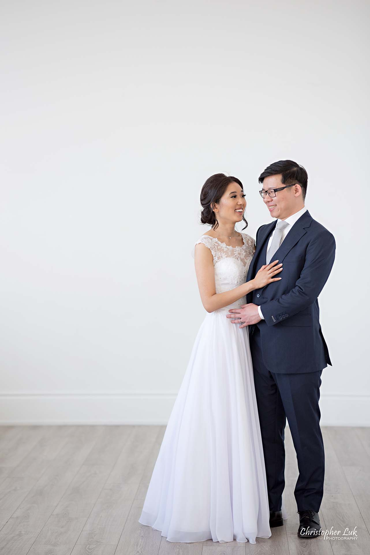 Christopher Luk Toronto Wedding Photographer - Mint Room Studios Bride Groom Natural Candid Photojournalistic Conservatory Ballroom Hug Laugh Looking Each Other Full Body