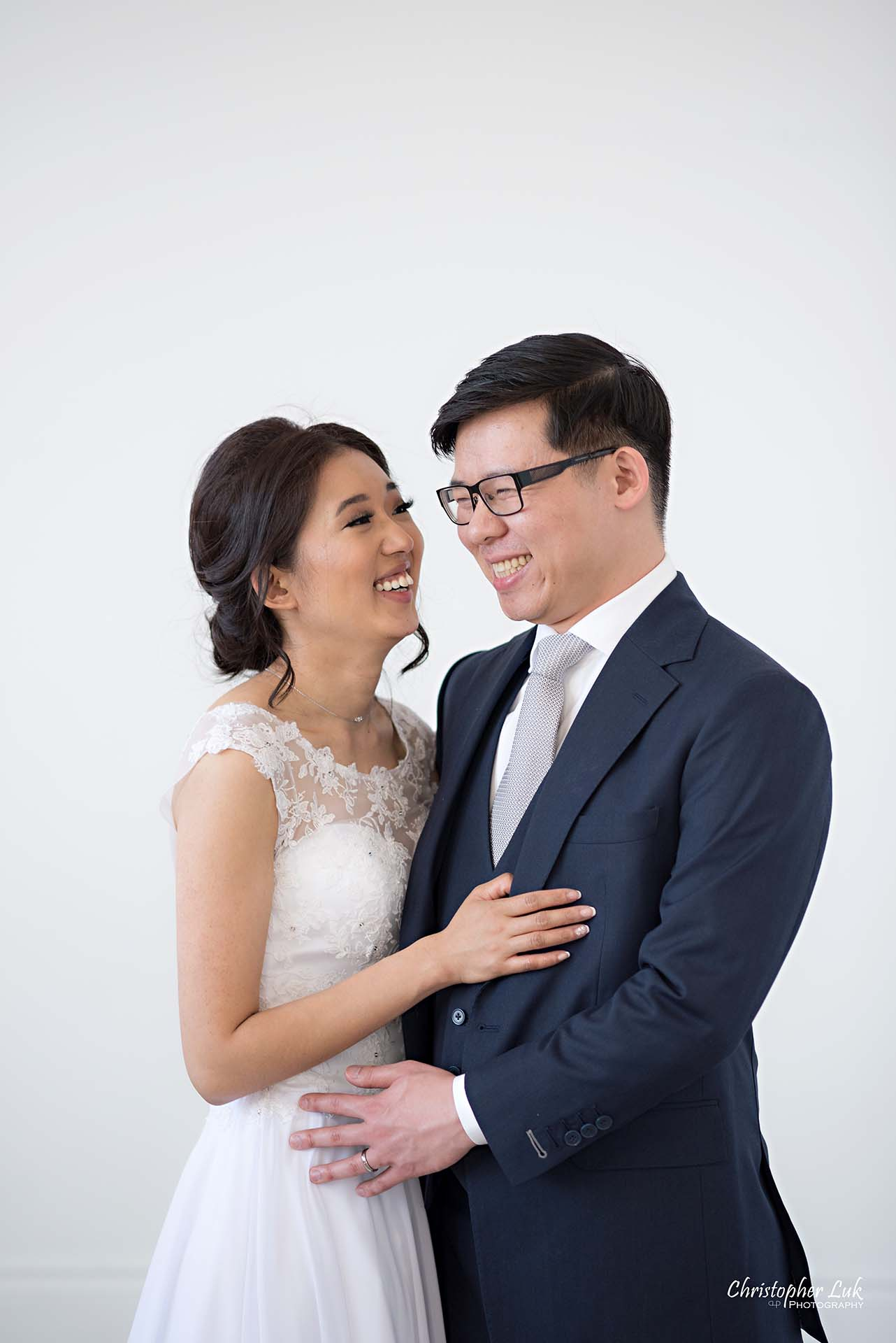 Christopher Luk Toronto Wedding Photographer - Mint Room Studios Bride Groom Natural Candid Photojournalistic Conservatory Ballroom Hug Laugh Looking Each Other Close