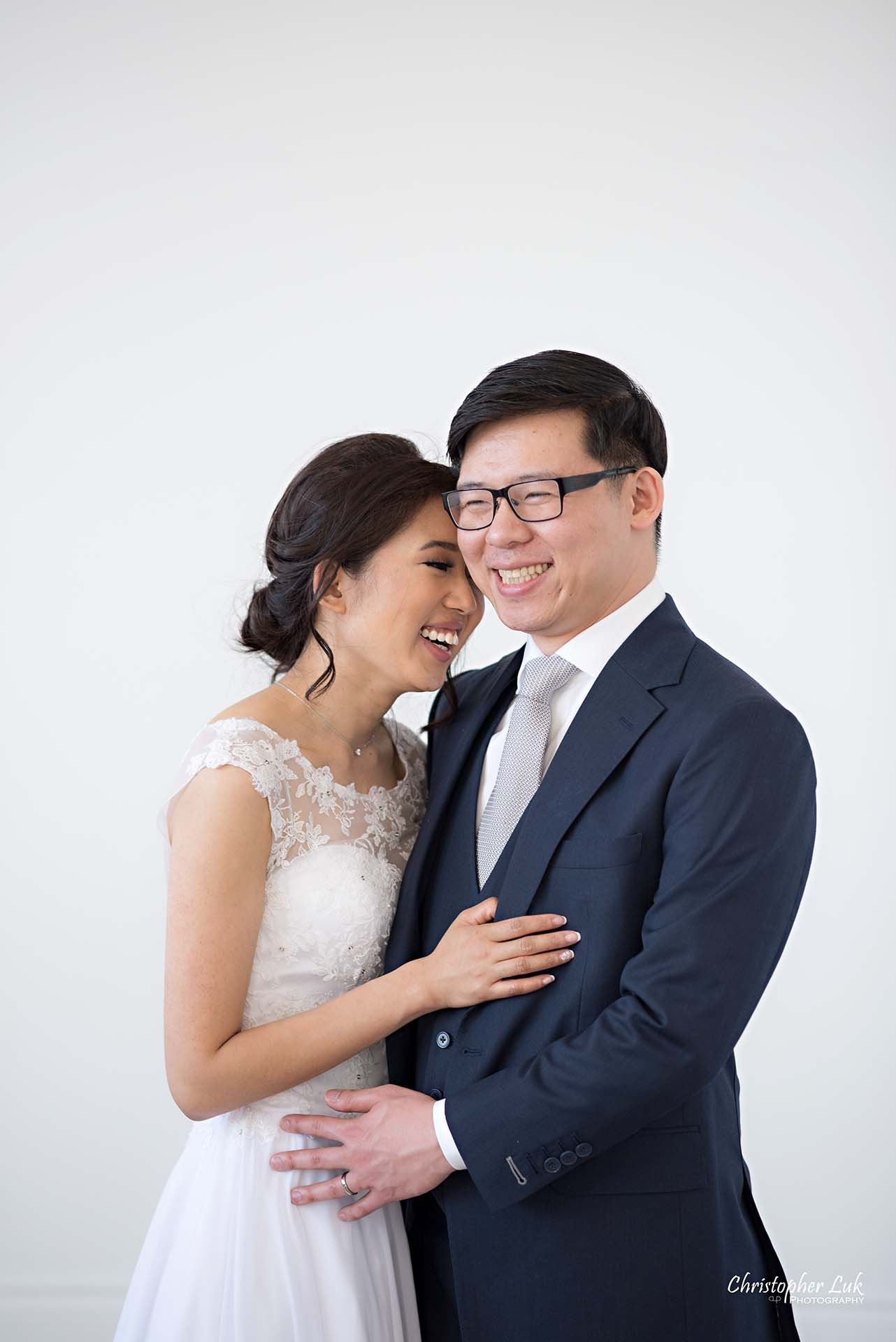 Christopher Luk Toronto Wedding Photographer - Mint Room Studios Bride Groom Natural Candid Photojournalistic Conservatory Ballroom Hug Laugh Holding Each Other Close