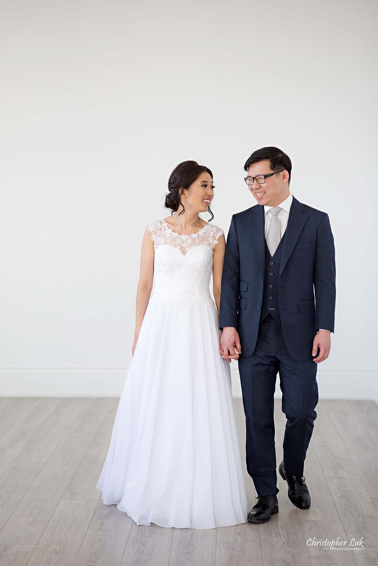 Christopher Luk Toronto Wedding Photographer - Mint Room Studios Bride Groom Natural Candid Photojournalistic Conservatory Ballroom Walking Together