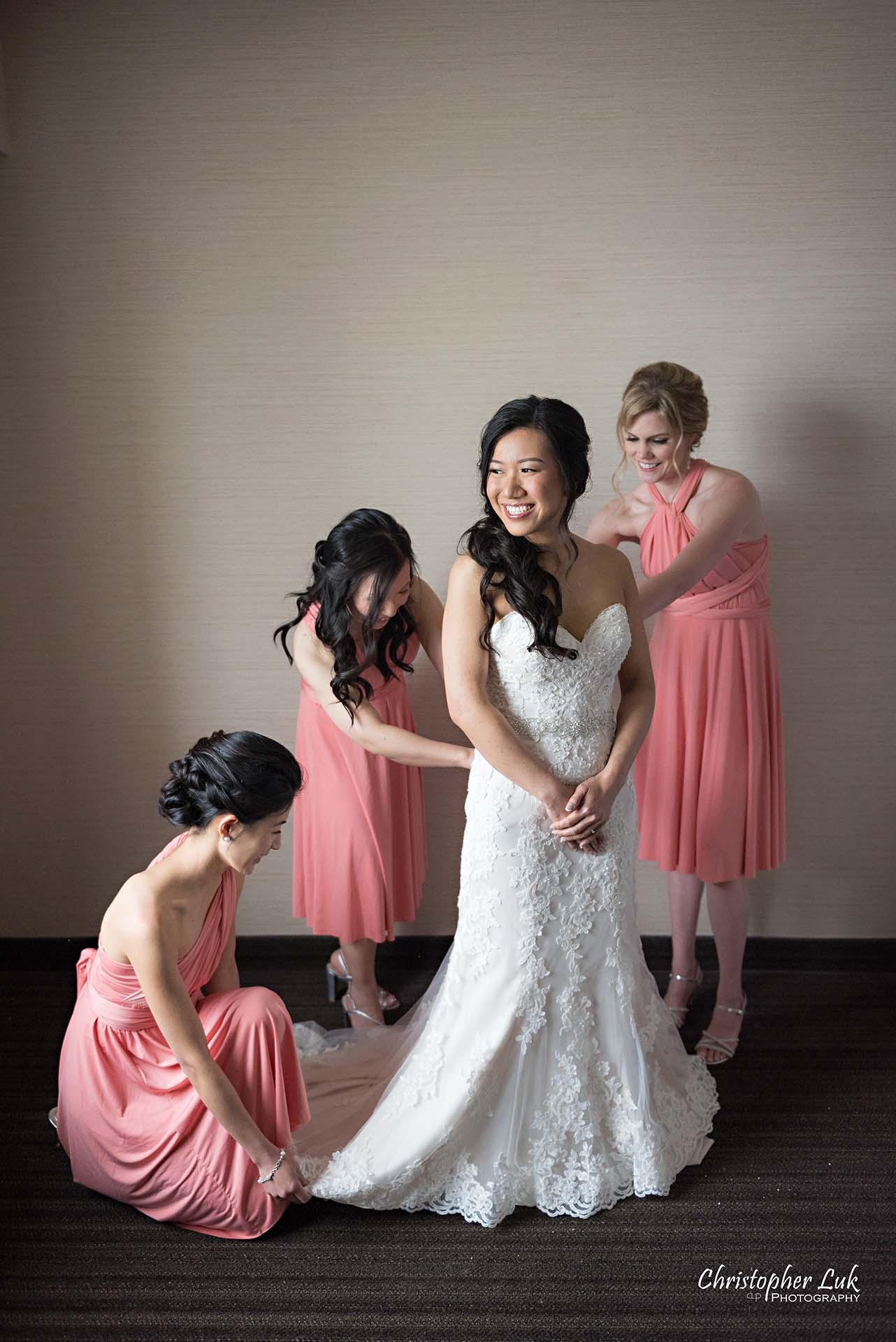 Christopher Luk Toronto Wedding Photographer Hotel Bride Getting Ready Details Maid of Honour Bridesmaids Candid Natural Photojournalistic Bridal Gown Dress Putting On