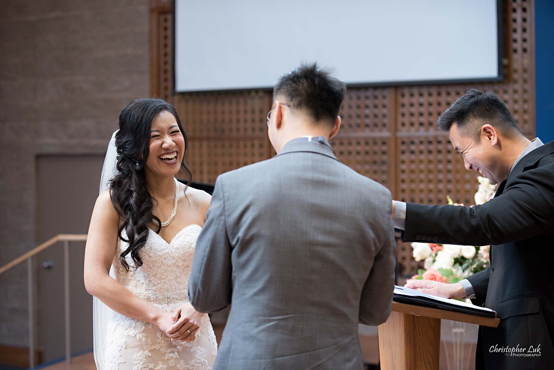 Christopher Luk Toronto Wedding Photographer Trinity York Mills Church Ceremony Sanctuary Candid Natural Photojournalistic Groom Bride Landscape Vows Reaction Laugh