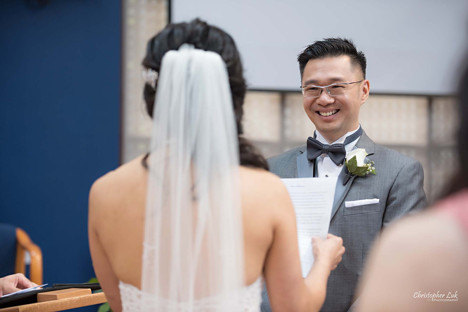 Christopher Luk Toronto Wedding Photographer Trinity York Mills Church Ceremony Sanctuary Candid Natural Photojournalistic Groom Vows Reaction Laugh