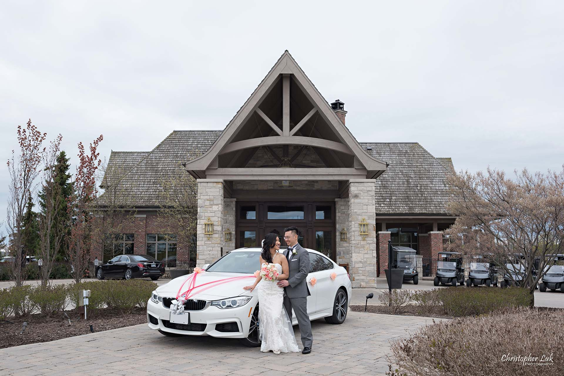 Christopher Luk Toronto Wedding Photographer Eagles Nest Golf Club Course Clubhouse Main Entrance Decorated Ribbons Car BMW 435i GT Gran Grand Coupe Bride Groom Hold Hug