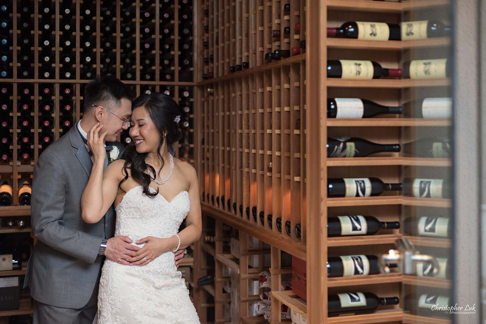 Christopher Luk Toronto Wedding Photographer Eagles Nest Golf Club Course Together Bride Groom Hold Hug Candid Natural Photojournalistic Nest Wine Cellar Intimate Left