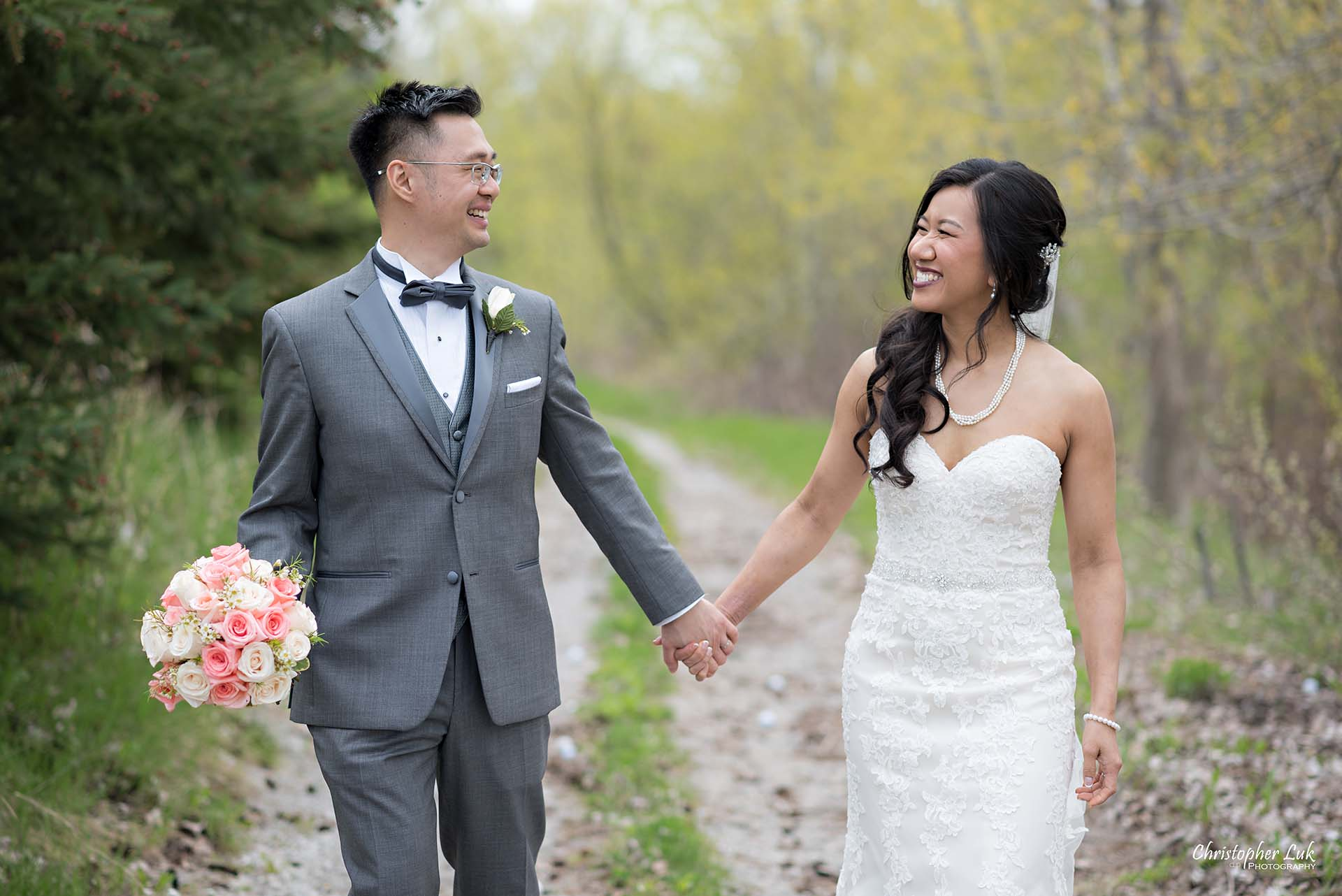 Christopher Luk Toronto Wedding Photographer Eagles Nest Golf Club Course Together Bride Groom Hold Hug Candid Natural Photojournalistic Walking Bouquet Flowers