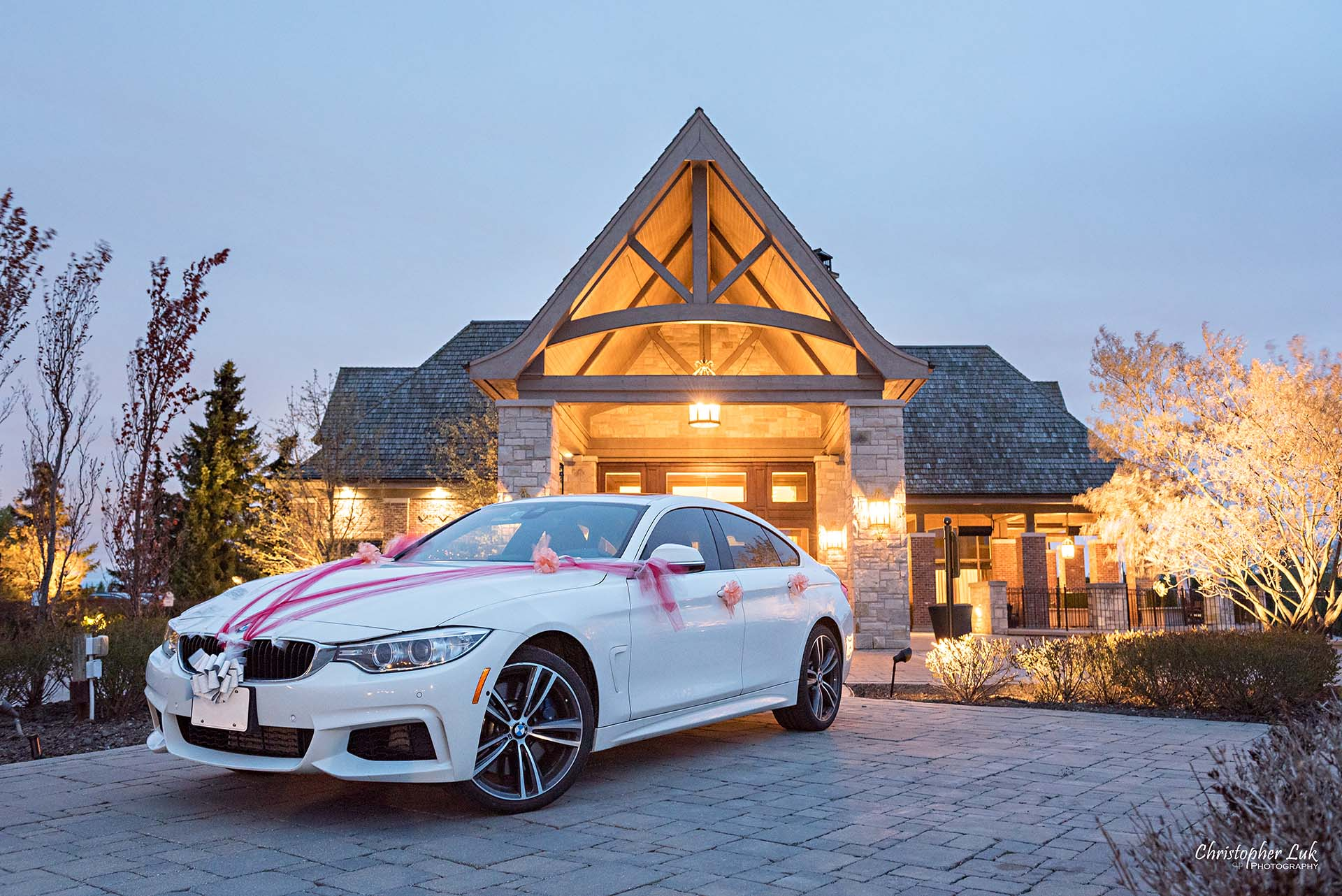 Christopher Luk Toronto Wedding Photographer Eagles Nest Golf Club Course Clubhouse Night Time Nighttime Sunset Long Exposure Driveway Main Entrance Steeple Landscape Decorated Ribbons Car BMW 435i GT Gran Grand Coupe Close