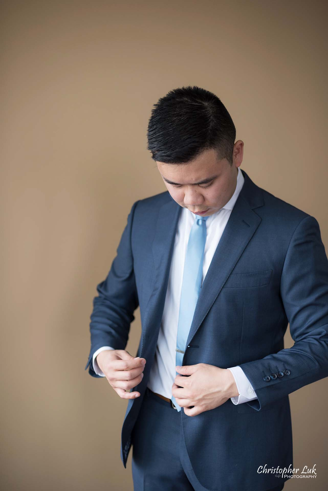 Christopher Luk Toronto Wedding Photographer Groom Getting Ready Preparations Natural Candid Photojournalistic Wingmen Suits Custom Made to Measure Navy Blue Suit Putting On Portrait