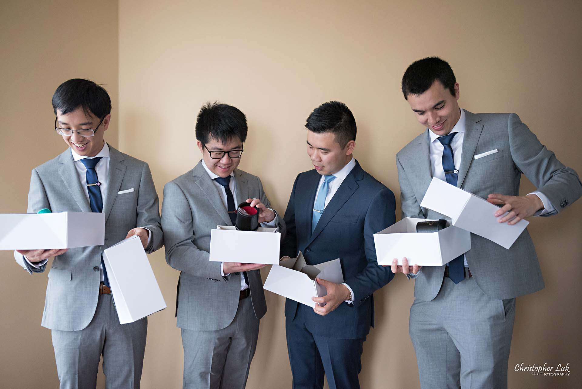 Christopher Luk Toronto Wedding Photographer Groom Getting Ready Preparations Natural Candid Photojournalistic Wingmen Suits Custom Made to Measure Navy Blue Suit Groomsmen Best Man Opening Gifts Presents