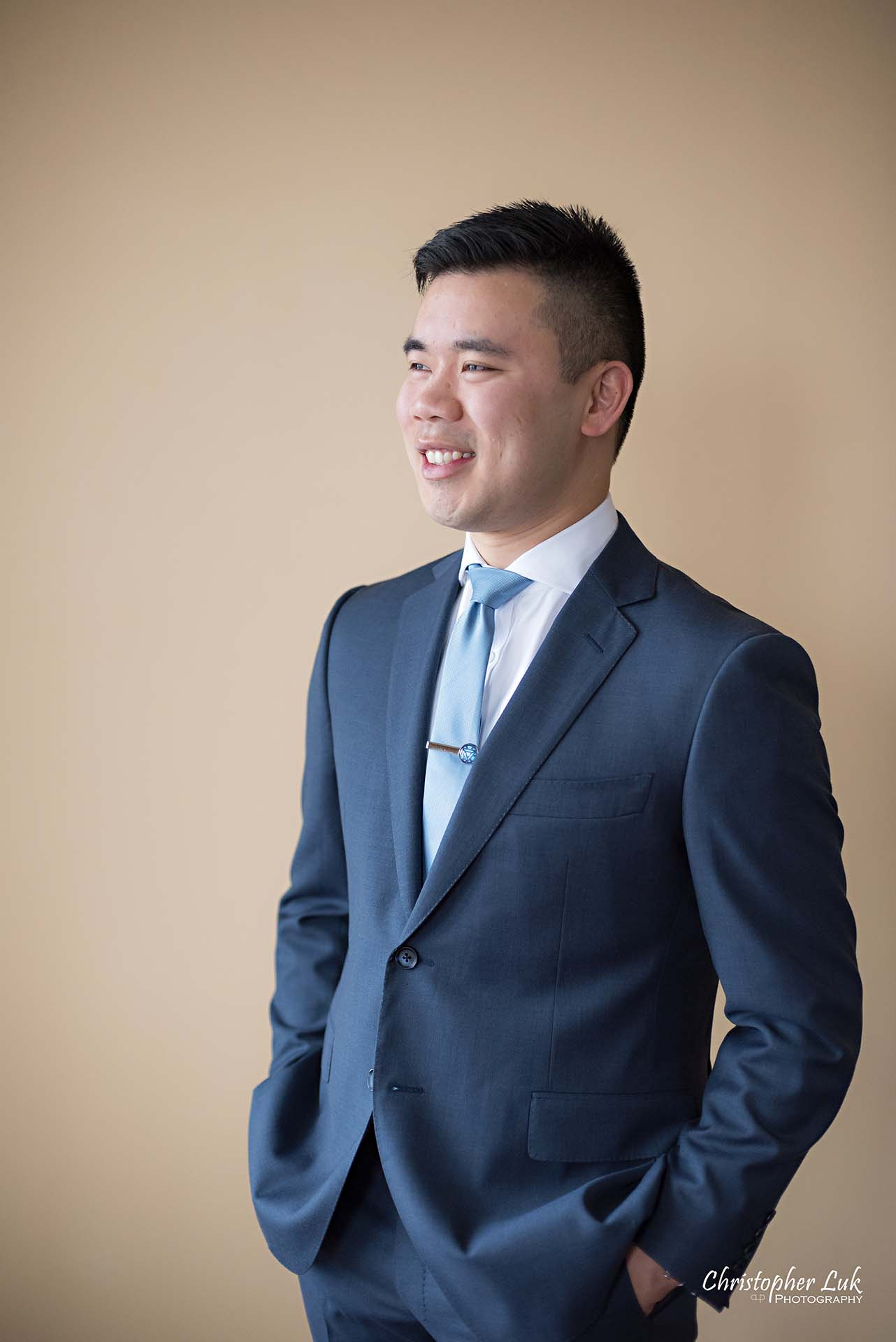 Christopher Luk Toronto Wedding Photographer Groom Getting Ready Preparations Natural Candid Photojournalistic Wingmen Suits Custom Made to Measure Navy Blue Suit Smile Portrait