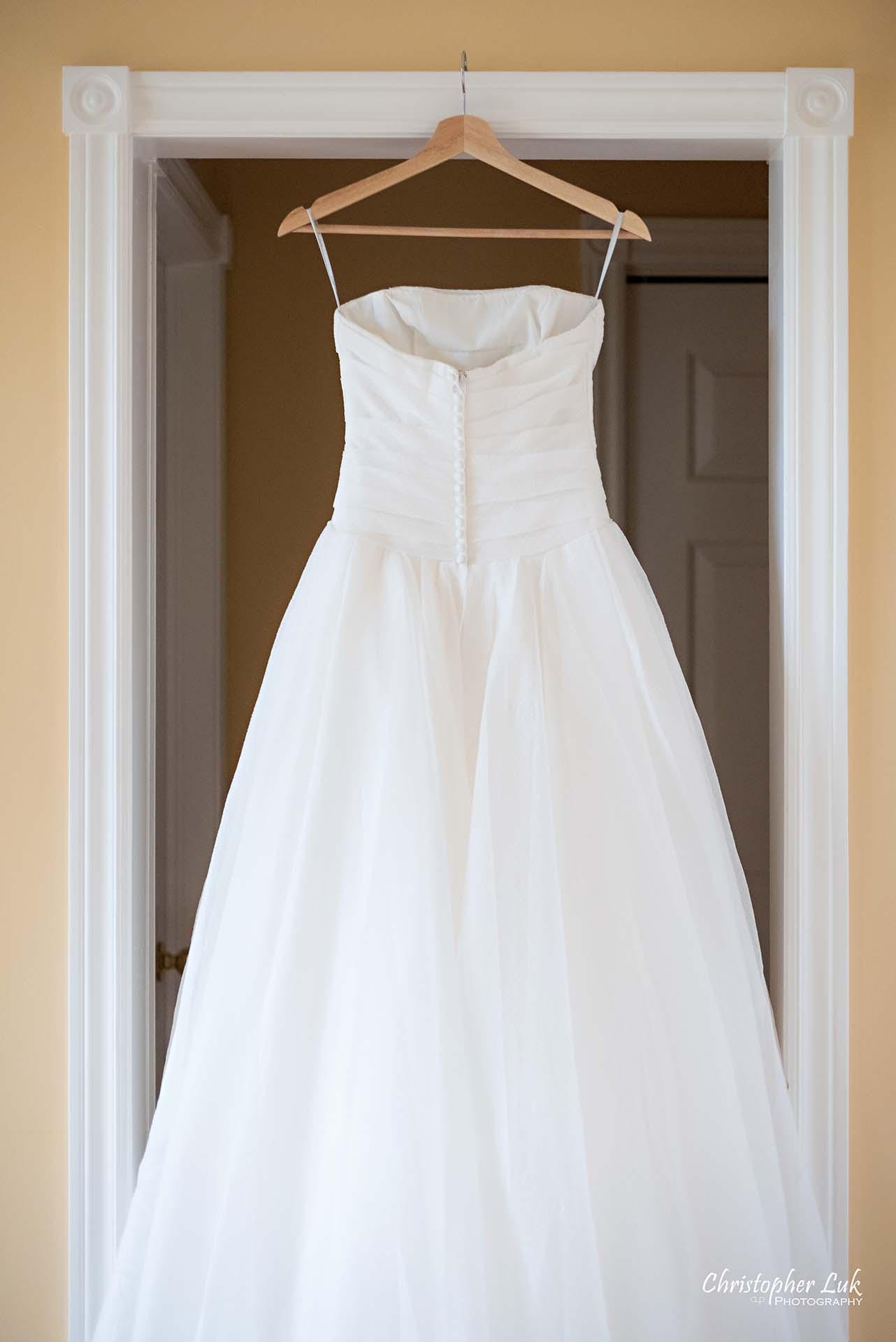Christopher Luk Toronto Wedding Photographer Bride Getting Ready Preparations Bridal White Gown Dress Hanging Back Train Detail