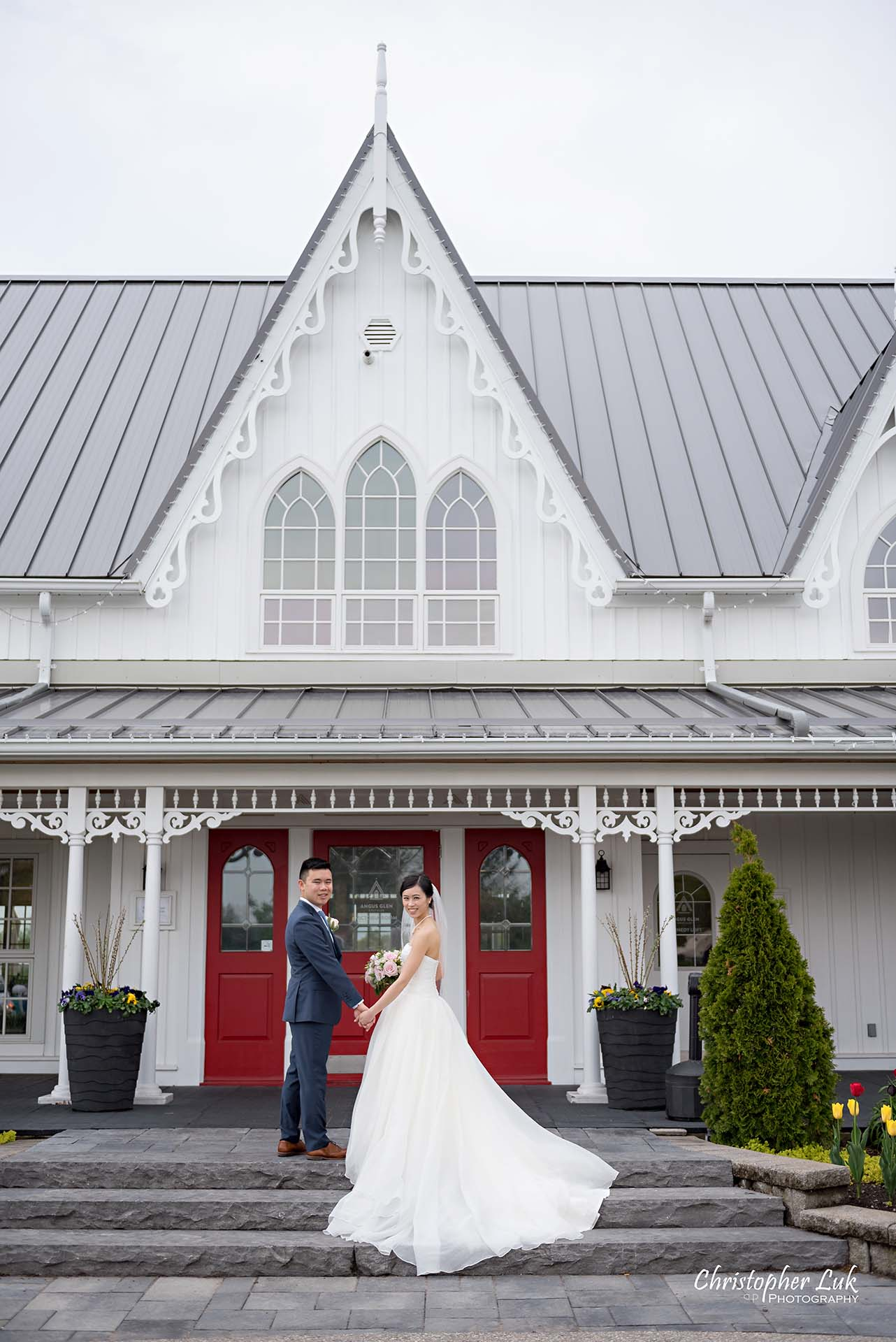 Christopher Luk Toronto Wedding Photographer Angus Glen Golf Club Markham Victoria Room Kennedy Loft Main Historic Estate Building Entrance Together Natural Candid Photojournalistic Bride Groom Bridal Gown Dress Train Staircase Looking at Camera Portrait