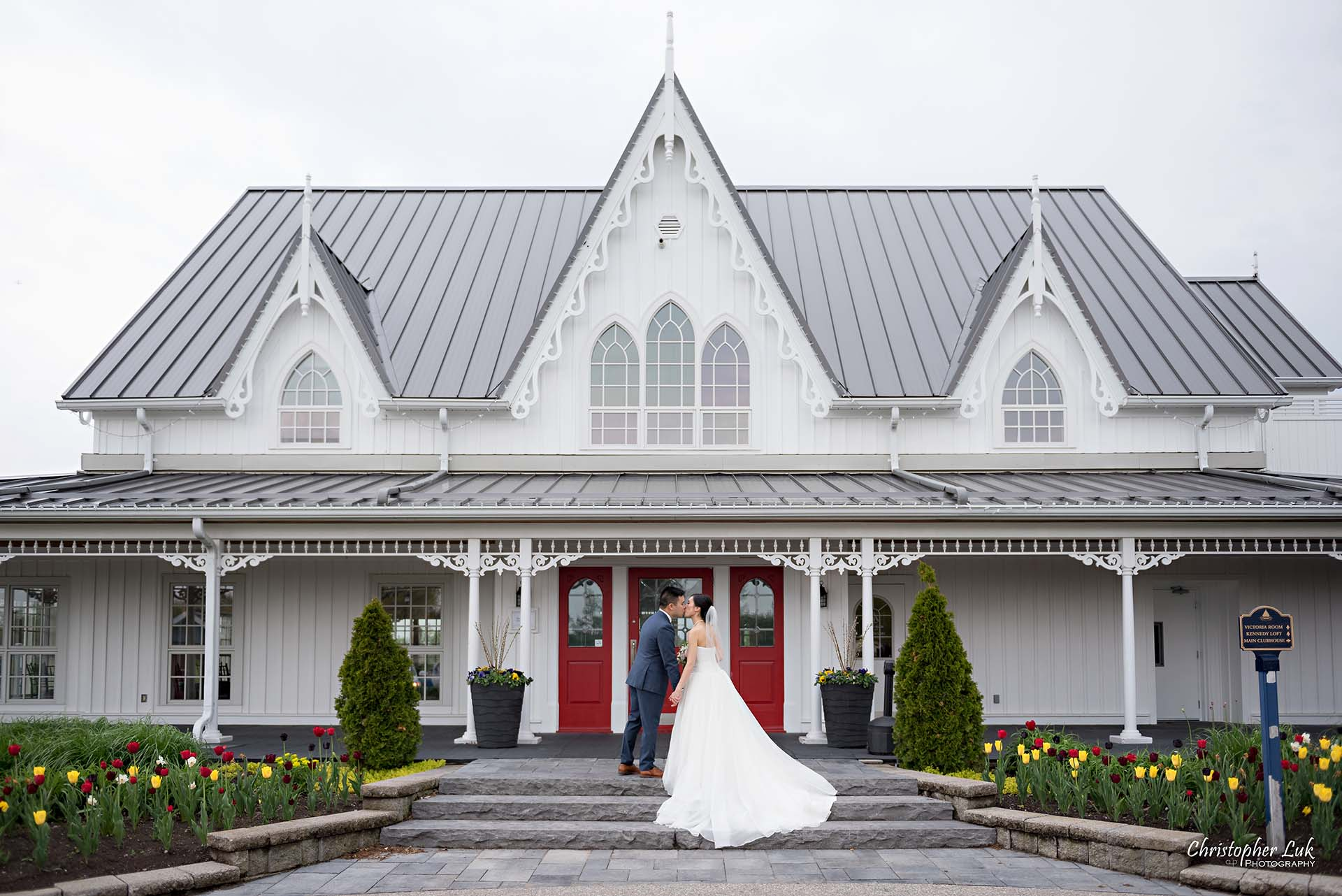 Christopher Luk Toronto Wedding Photographer Angus Glen Golf Club Markham Victoria Room Kennedy Loft Main Historic Estate Building Entrance Together Natural Candid Photojournalistic Bride Groom Bridal Gown Dress Train Staircase Kiss