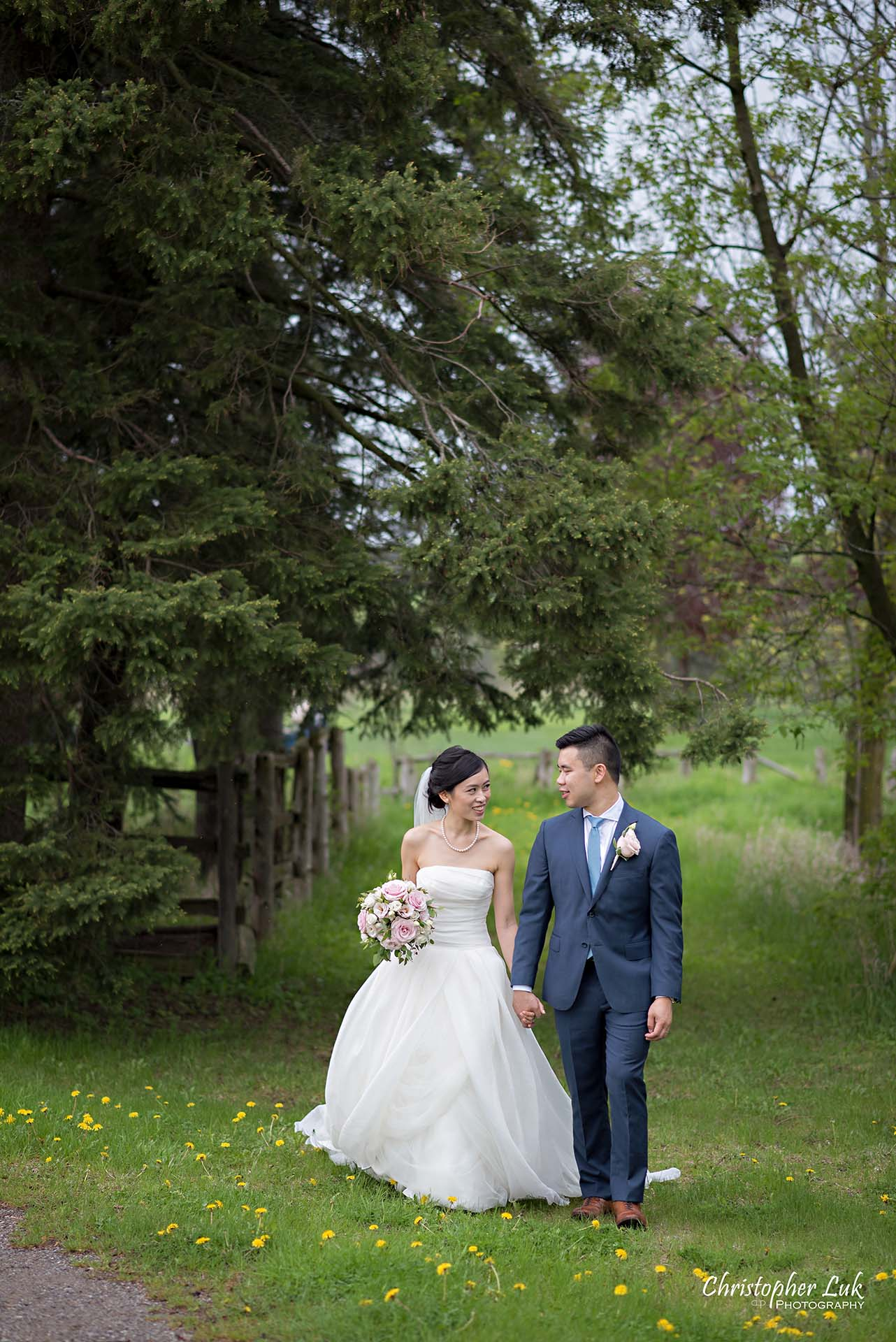 Christopher Luk Toronto Wedding Photographer Angus Glen Golf Club Markham Main Blue Barn Farm Historic Estate Building Together Natural Candid Photojournalistic Bride Groom Holding Hands Together Walking Green Trees