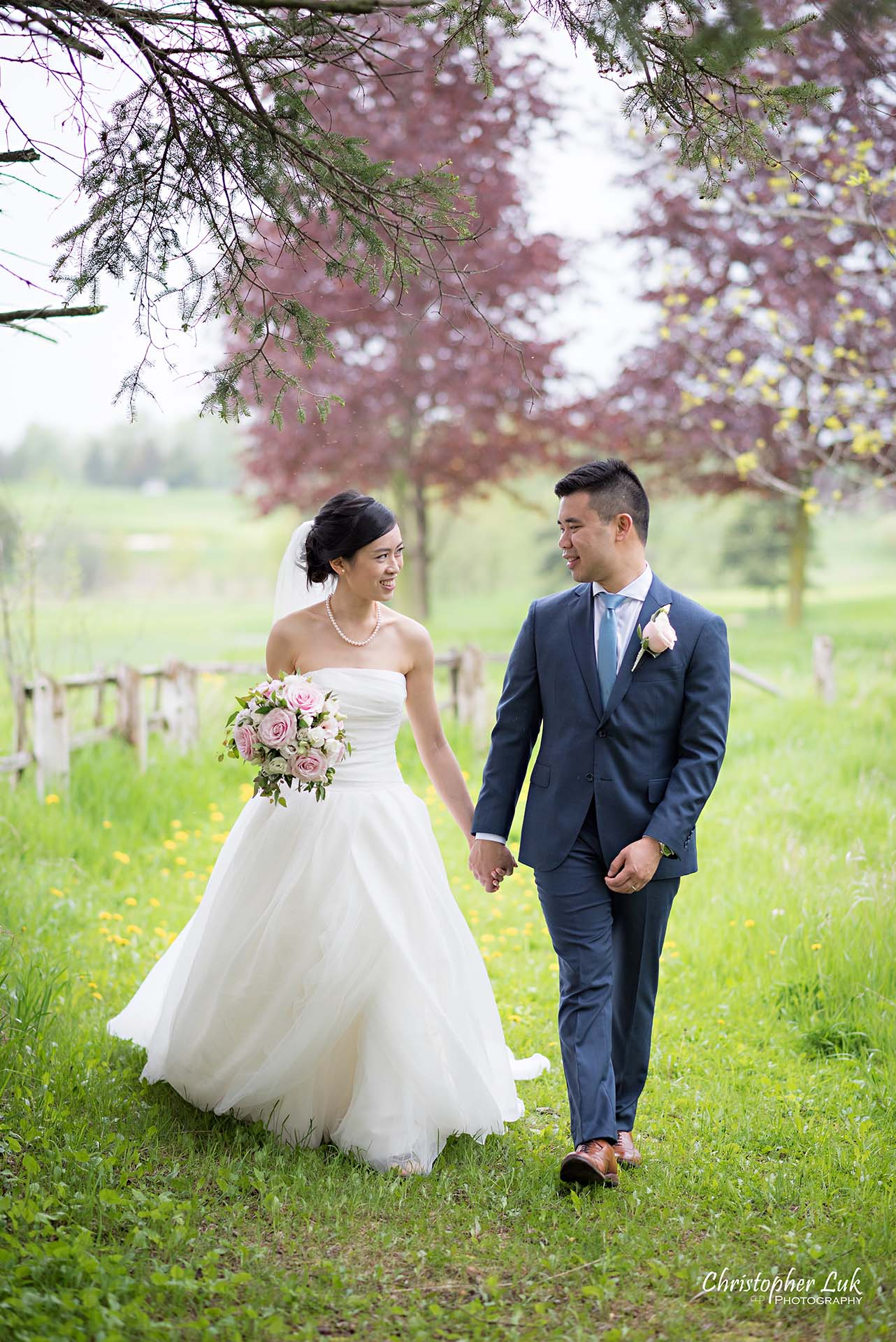 Christopher Luk Toronto Wedding Photographer Angus Glen Golf Club Markham Main Blue Barn Farm Historic Estate Building Together Natural Candid Photojournalistic Bride Groom Holding Hands Together Walking Green Grass Pathway Portrait 2