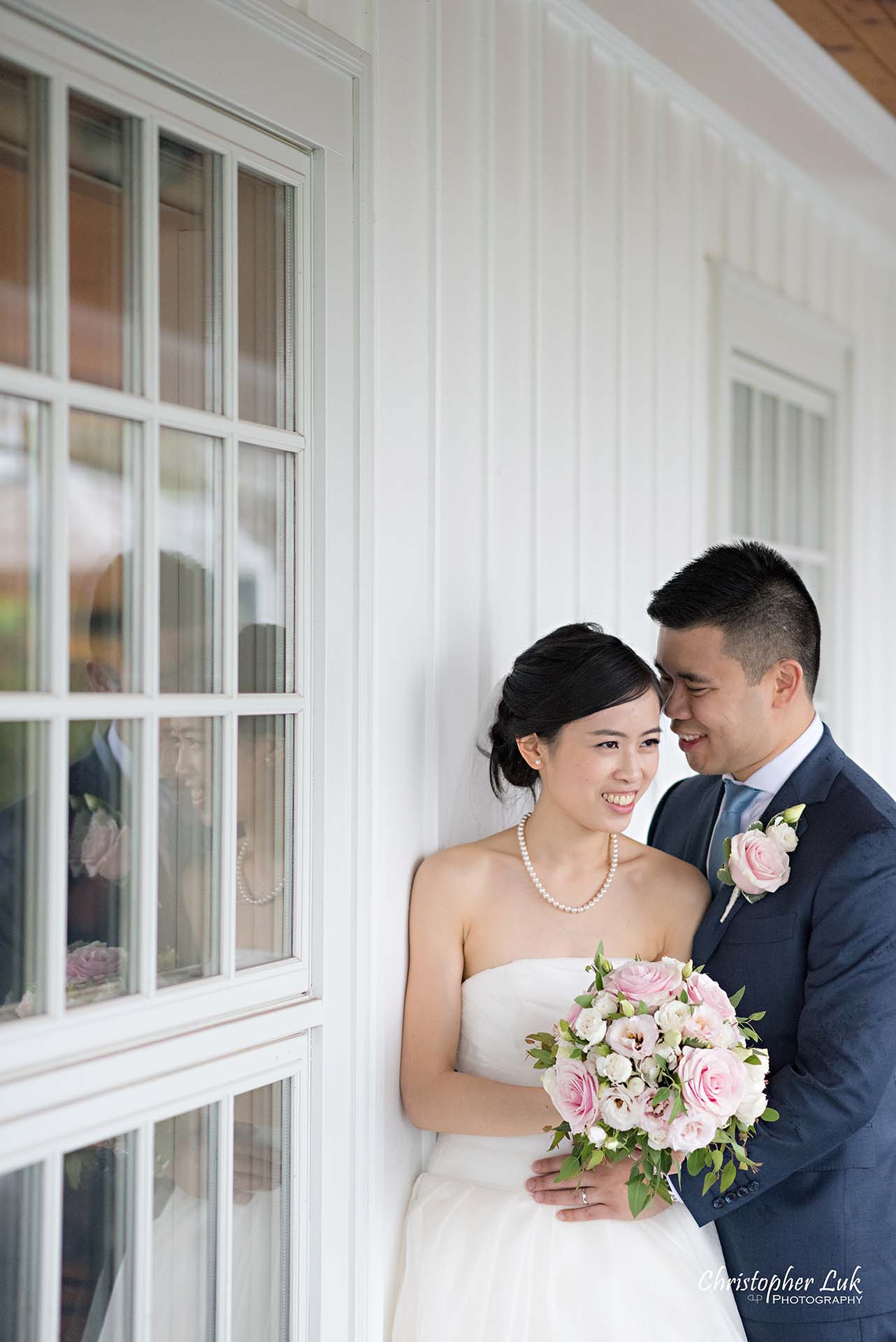 Christopher Luk Toronto Wedding Photographer Angus Glen Golf Club Markham Victoria Room Kennedy Loft Main Historic Estate Building Entrance Together Natural Candid Photojournalistic Bride Groom White Wall Window Reflection Intimate Hug