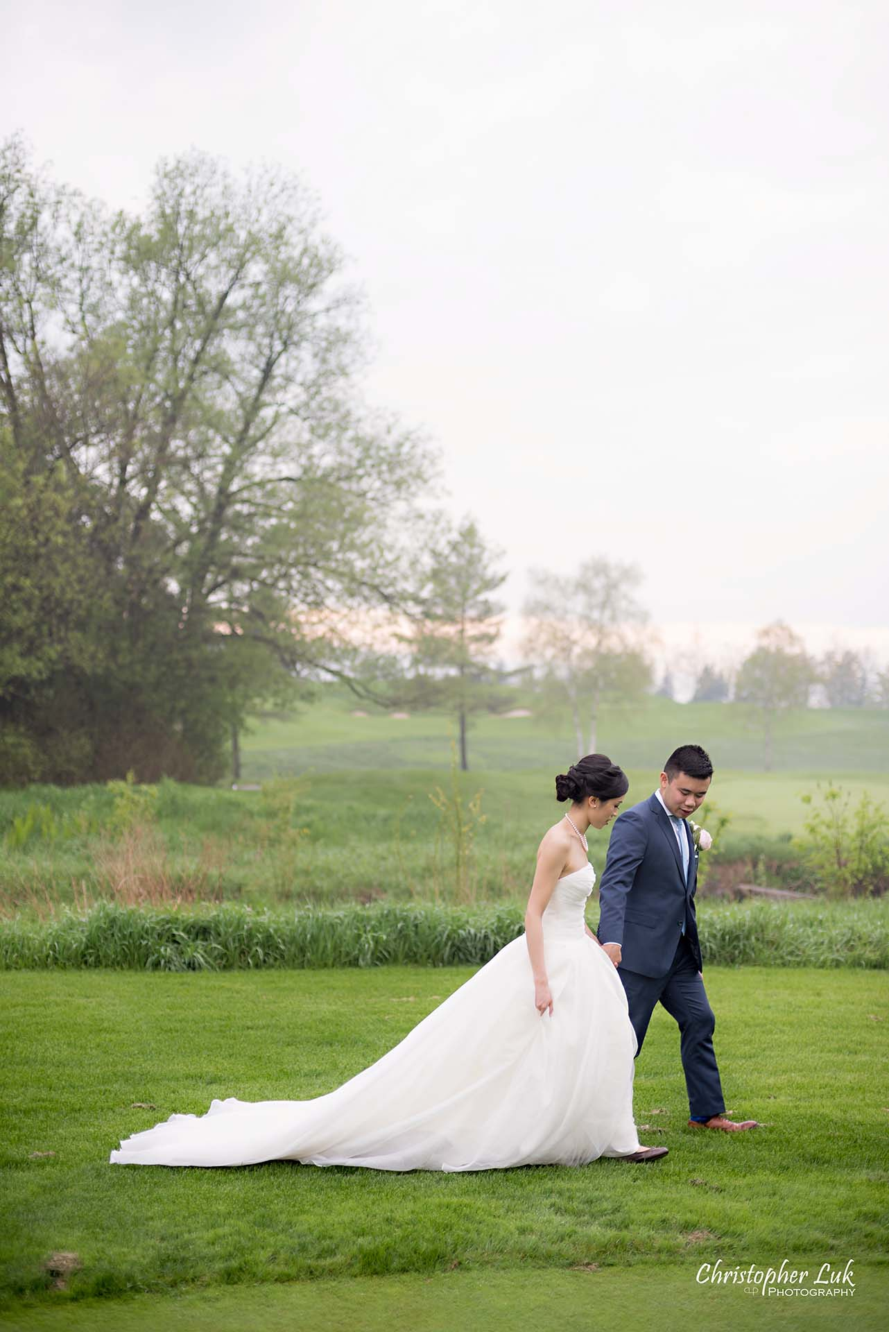 Christopher Luk Toronto Wedding Photographer Angus Glen Golf Club Markham Great Hall Dinner Reception Event Venue Green Field Sunset Bride Groom Natural Candid Photojournalistic Walking Together