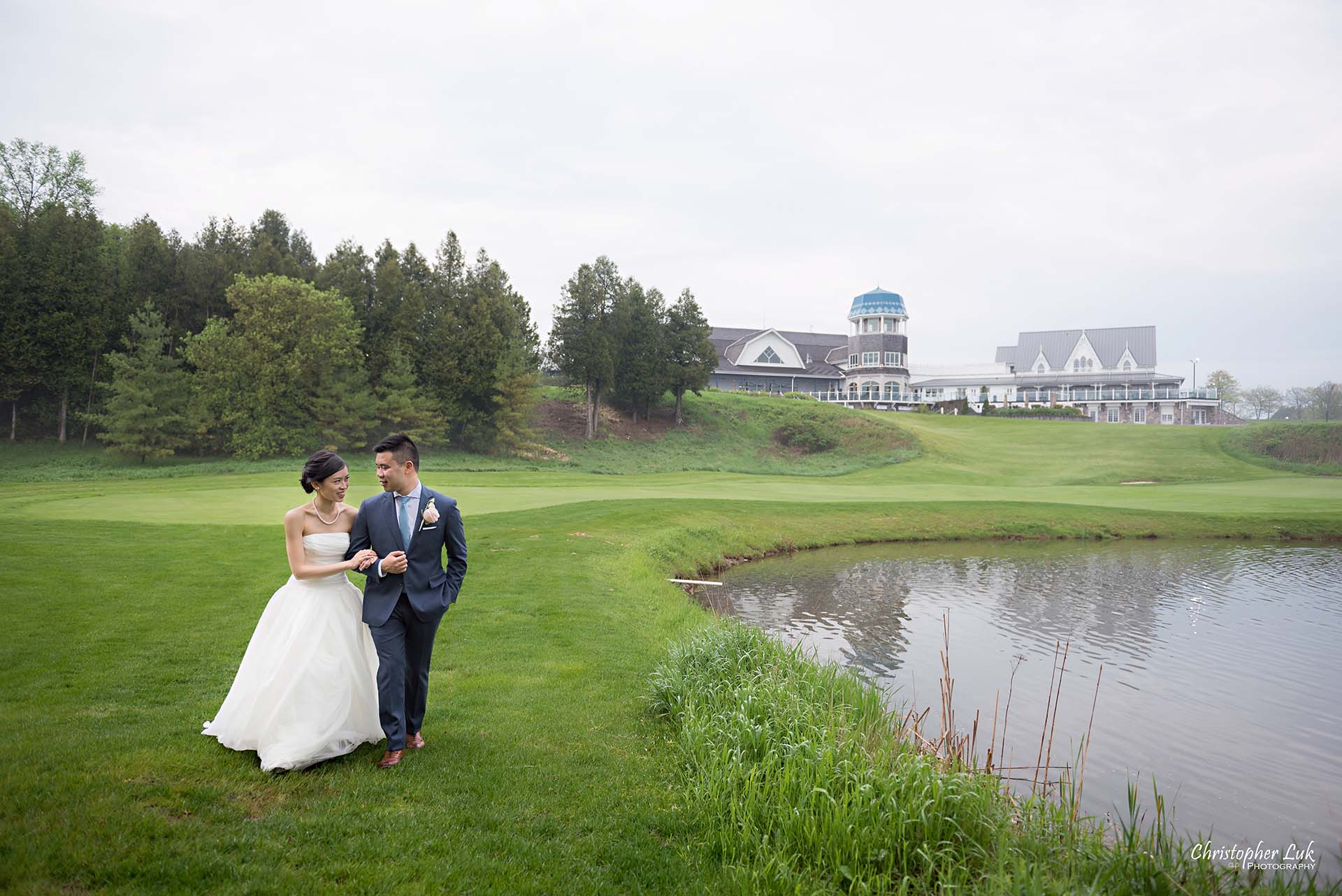 Christopher Luk Toronto Wedding Photographer Angus Glen Golf Club Markham Great Hall Dinner Reception Event Venue Green Field Sunset Bride Groom Natural Candid Photojournalistic Walking Together Green Pond Lake Clubhouse Landscape