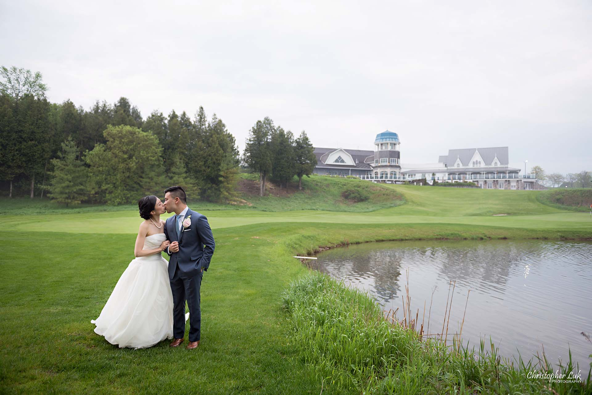 Christopher Luk Toronto Wedding Photographer Angus Glen Golf Club Markham Great Hall Dinner Reception Event Venue Green Field Sunset Bride Groom Natural Candid Photojournalistic Walking Together Green Pond Lake Clubhouse Landscape Kiss