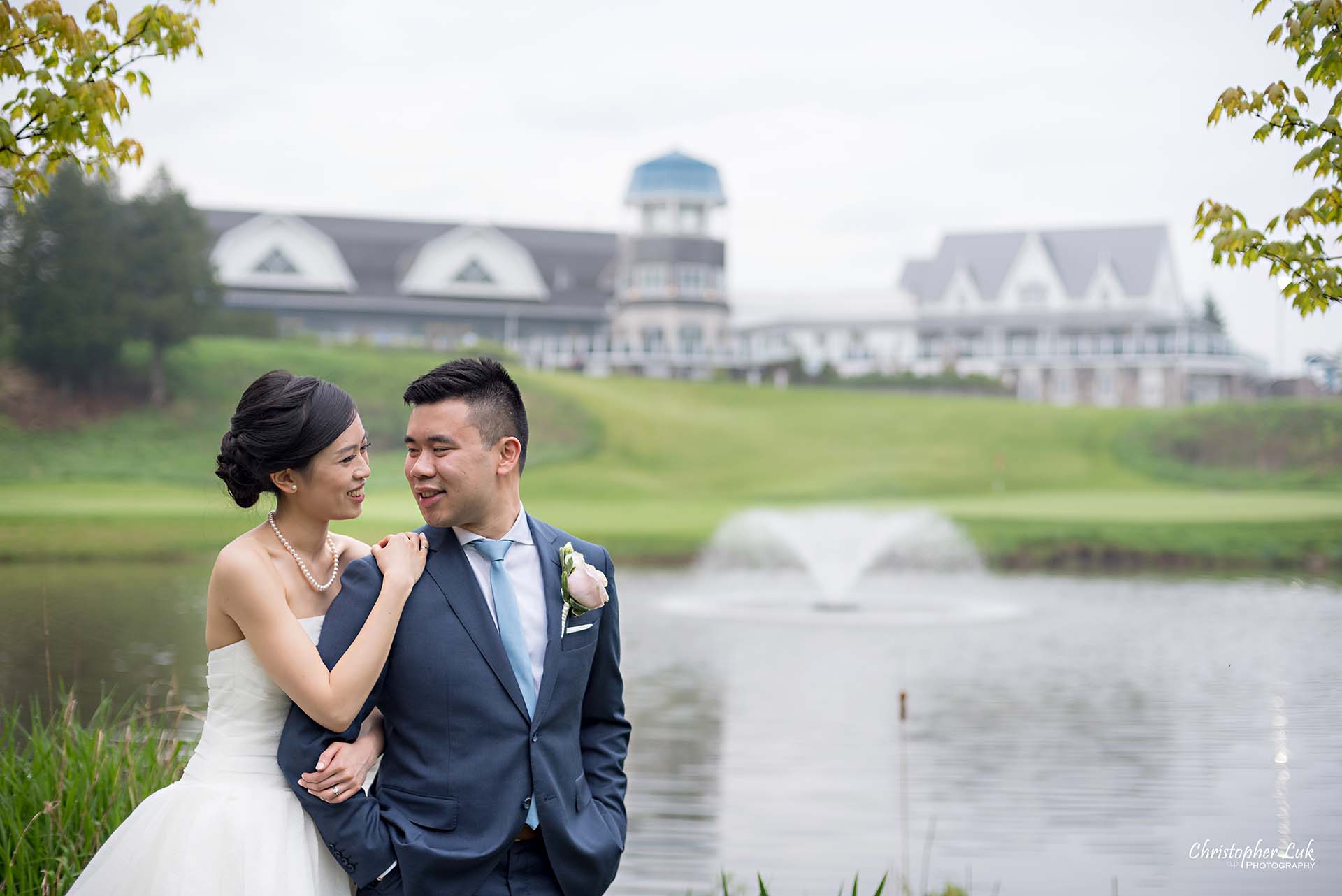 Christopher Luk Toronto Wedding Photographer Angus Glen Golf Club Markham Great Hall Dinner Reception Event Venue Green Field Sunset Bride Groom Natural Candid Photojournalistic Hold Each Other Hug Together Green Pond Lake Clubhouse Landscape Water Fountain