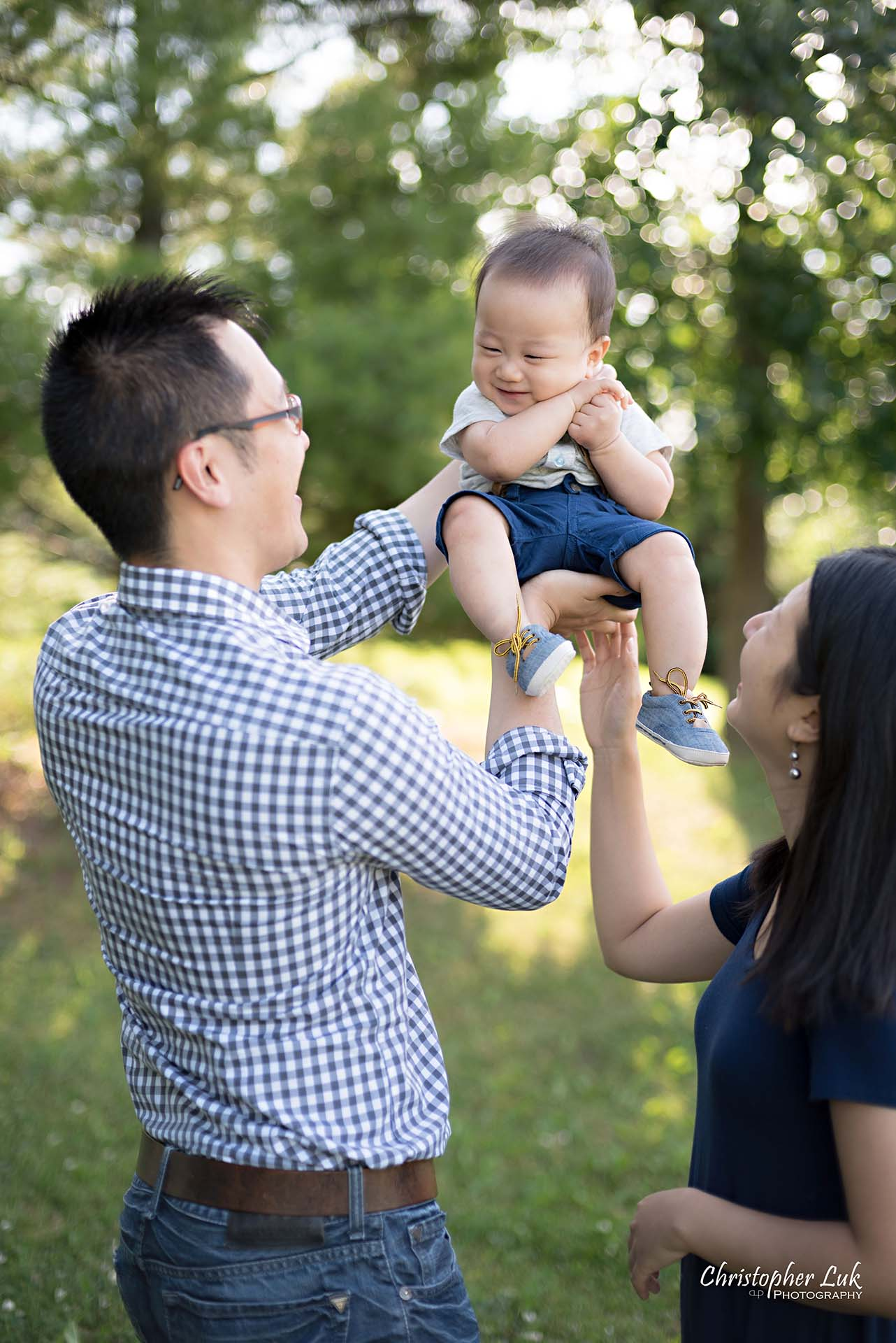 Christopher Luk Family Baby Wedding Photographer Richmond Hill Markham Toronto - Candid Natural Photojournalistic Father Mother Dad Mom Motherhood Fatherhood Baby Smile Cute Adorable Lifted Up Simba Lion King Smile Laugh