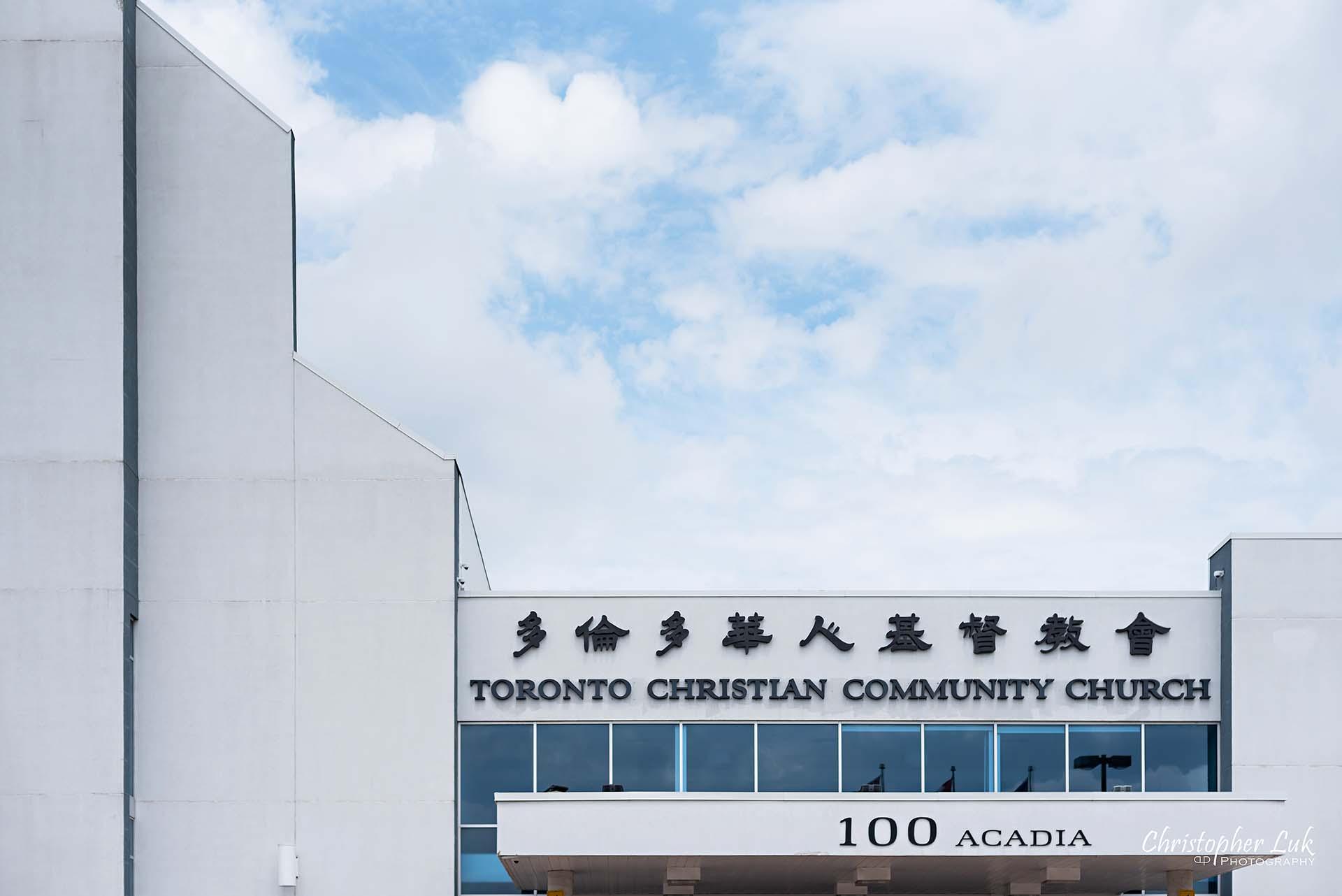 Christopher Luk Toronto Christian Community Church Kleinburg McMichael Art Gallery Presidente Banquet Hall Vaughan Wedding Photographer T3C TCCC Building Exterior Feature Cross Blue Sky Clouds Entrance Sign