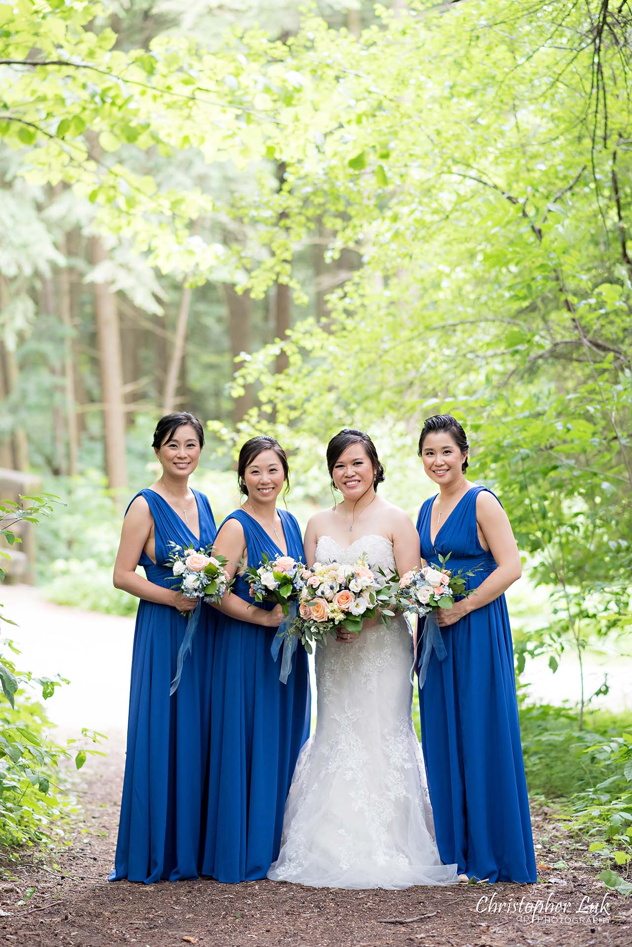 Christopher Luk Toronto Christian Community Church Kleinburg McMichael Art Gallery Presidente Banquet Hall Vaughan Wedding Photographer Bride Bridal Party Bridesmaids Matron Maid of Honour Natural Candid Photojournalistic Forest Woods Wooded Area Tall Trees Blue Dresses Smile