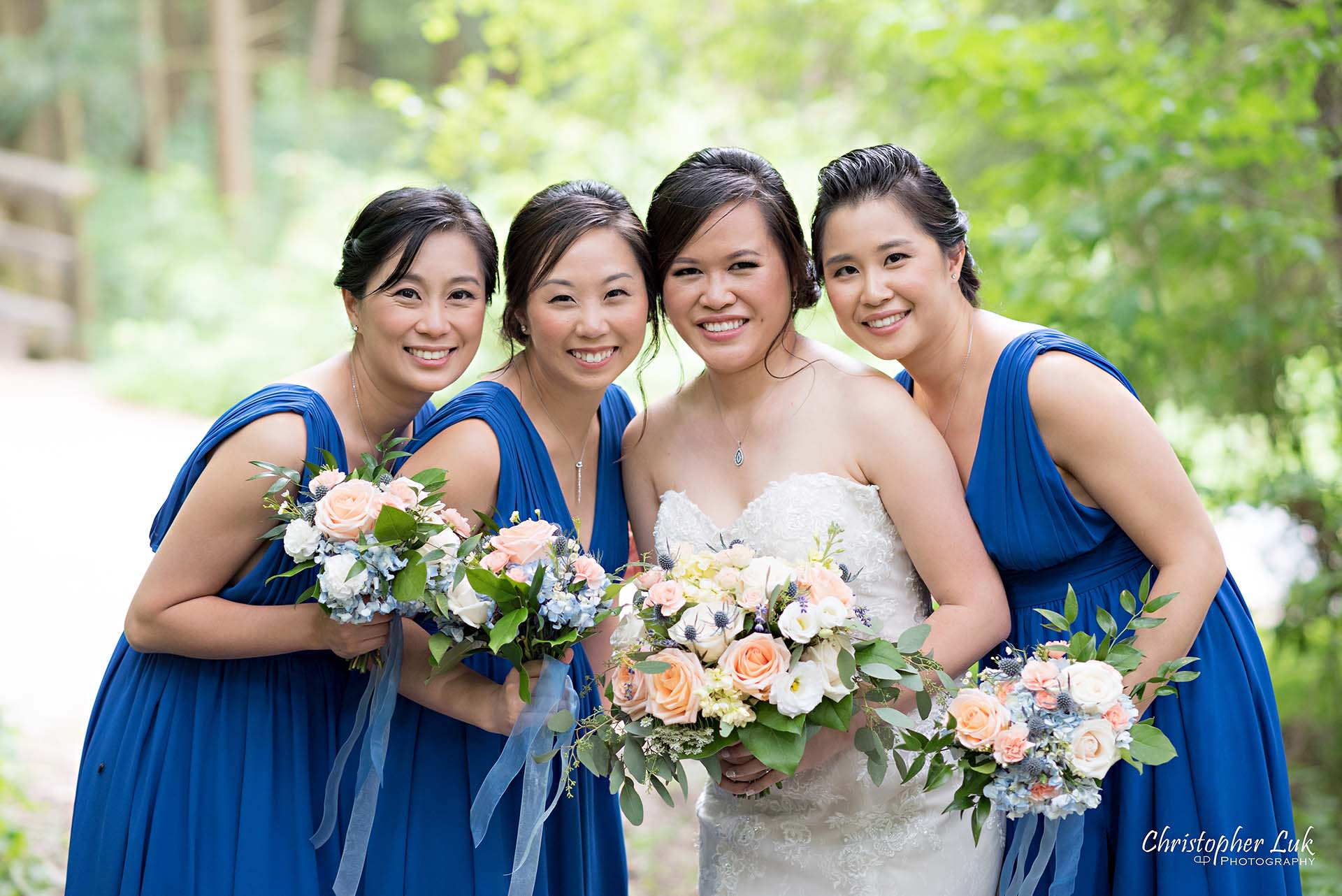 Christopher Luk Toronto Christian Community Church Kleinburg McMichael Art Gallery Presidente Banquet Hall Vaughan Wedding Photographer Bride Bridal Party Bridesmaids Matron Maid of Honour Natural Candid Photojournalistic Forest Woods Wooded Area Tall Trees Blue Dresses Smile Close Up Detail