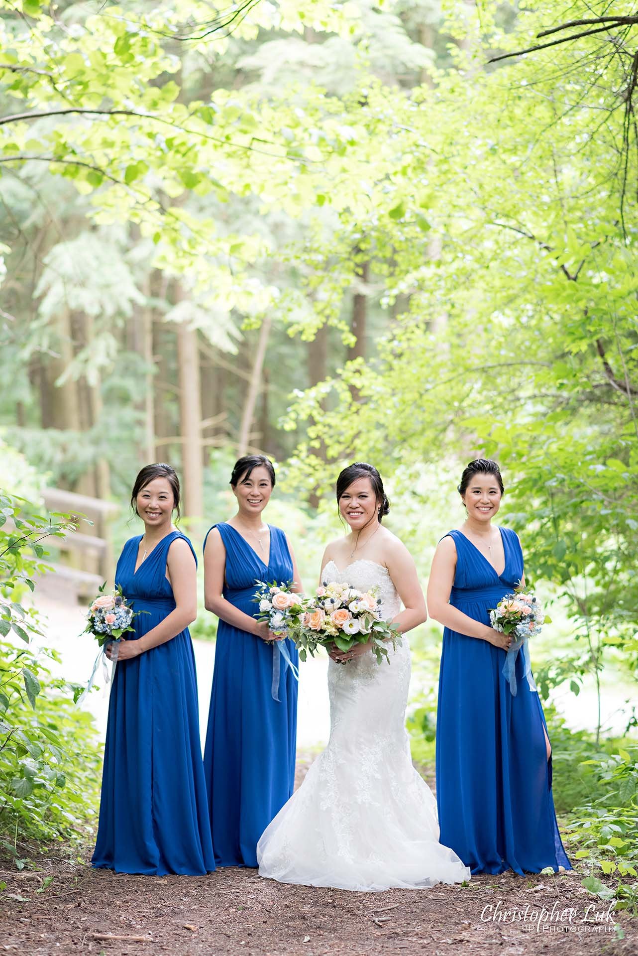 Christopher Luk Toronto Christian Community Church Kleinburg McMichael Art Gallery Presidente Banquet Hall Vaughan Wedding Photographer Bride Bridal Party Bridesmaids Matron Maid of Honour Natural Candid Photojournalistic Forest Woods Wooded Area Tall Trees Blue Dresses Smile Creative Pose