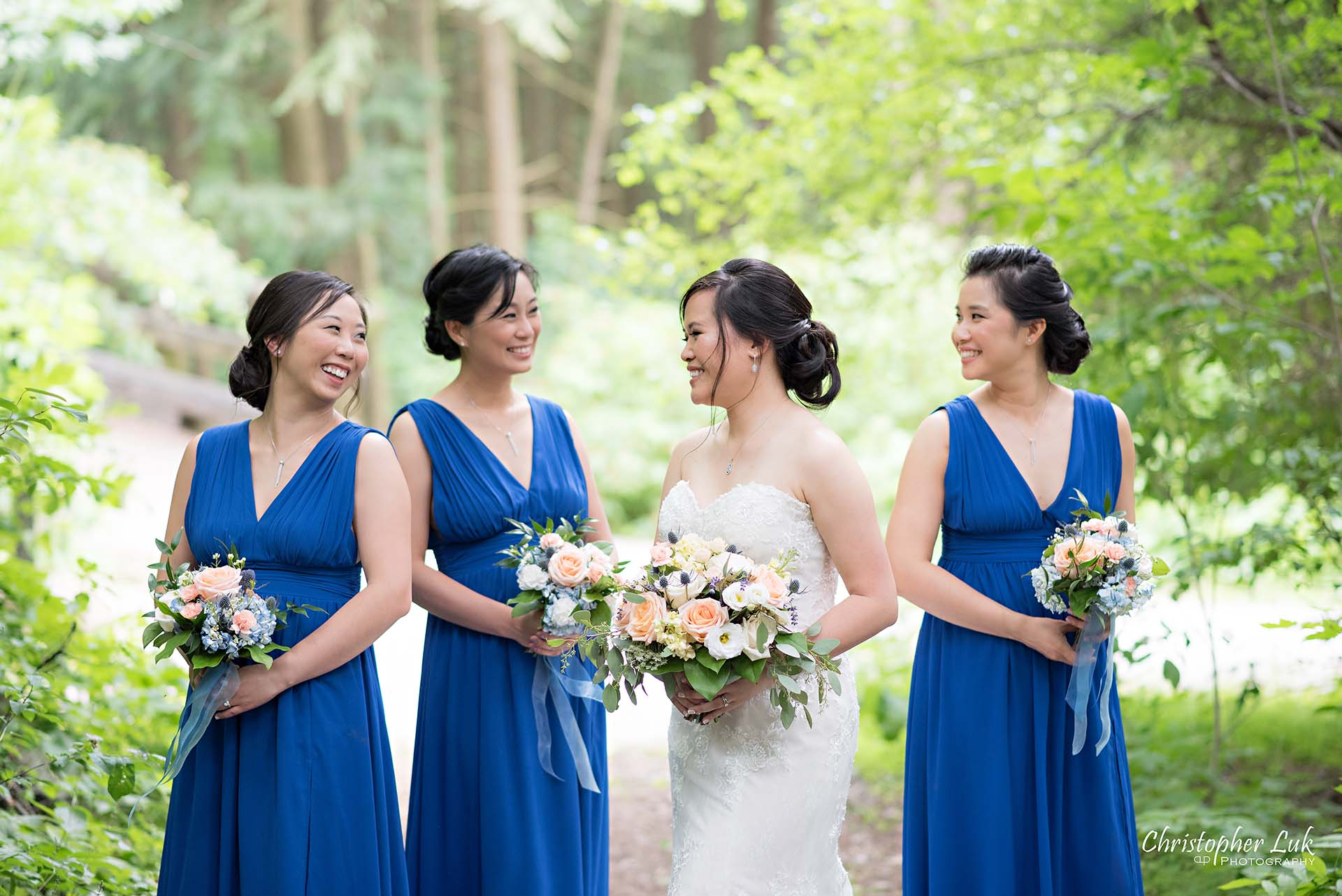 Christopher Luk Toronto Christian Community Church Kleinburg McMichael Art Gallery Presidente Banquet Hall Vaughan Wedding Photographer Bride Bridal Party Bridesmaids Matron Maid of Honour Natural Candid Photojournalistic Forest Woods Wooded Area Tall Trees Blue Dresses Laughing Together