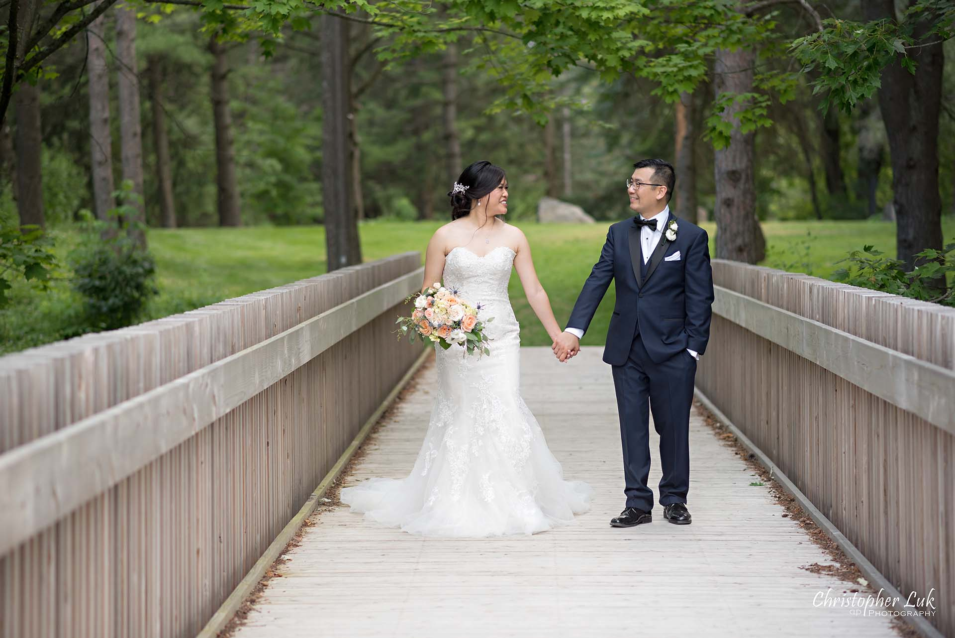 Christopher Luk Toronto Christian Community Church Kleinburg McMichael Art Gallery Vaughan Wedding Photographer Bride Groom Candid Natural Photojournalistic Wooden Bridge Boardwalk Intimate Leading Lines Looking at Each Other Walking