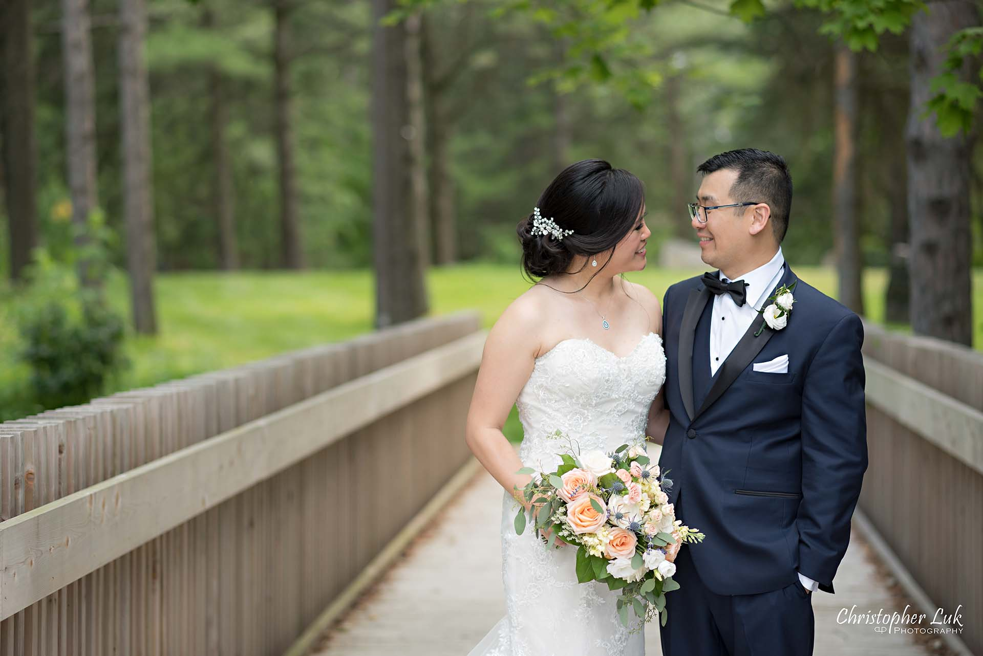 Christopher Luk Toronto Christian Community Church Kleinburg McMichael Art Gallery Vaughan Wedding Photographer Bride Groom Candid Natural Photojournalistic Wooden Bridge Boardwalk Intimate Leading Lines Looking at Each Other Smile