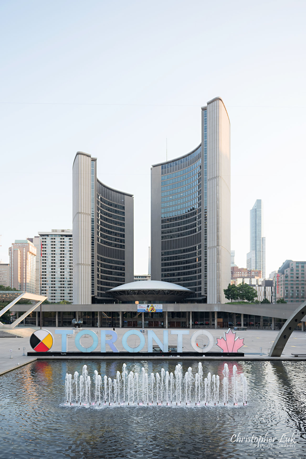 Christopher Luk Wedding Photographer Toronto City Hall Nathan Philips Square Elevated Bridge Arches Archway Wide Landscape Toronto 3D Sign Water Pool Fountain Feature Portrait