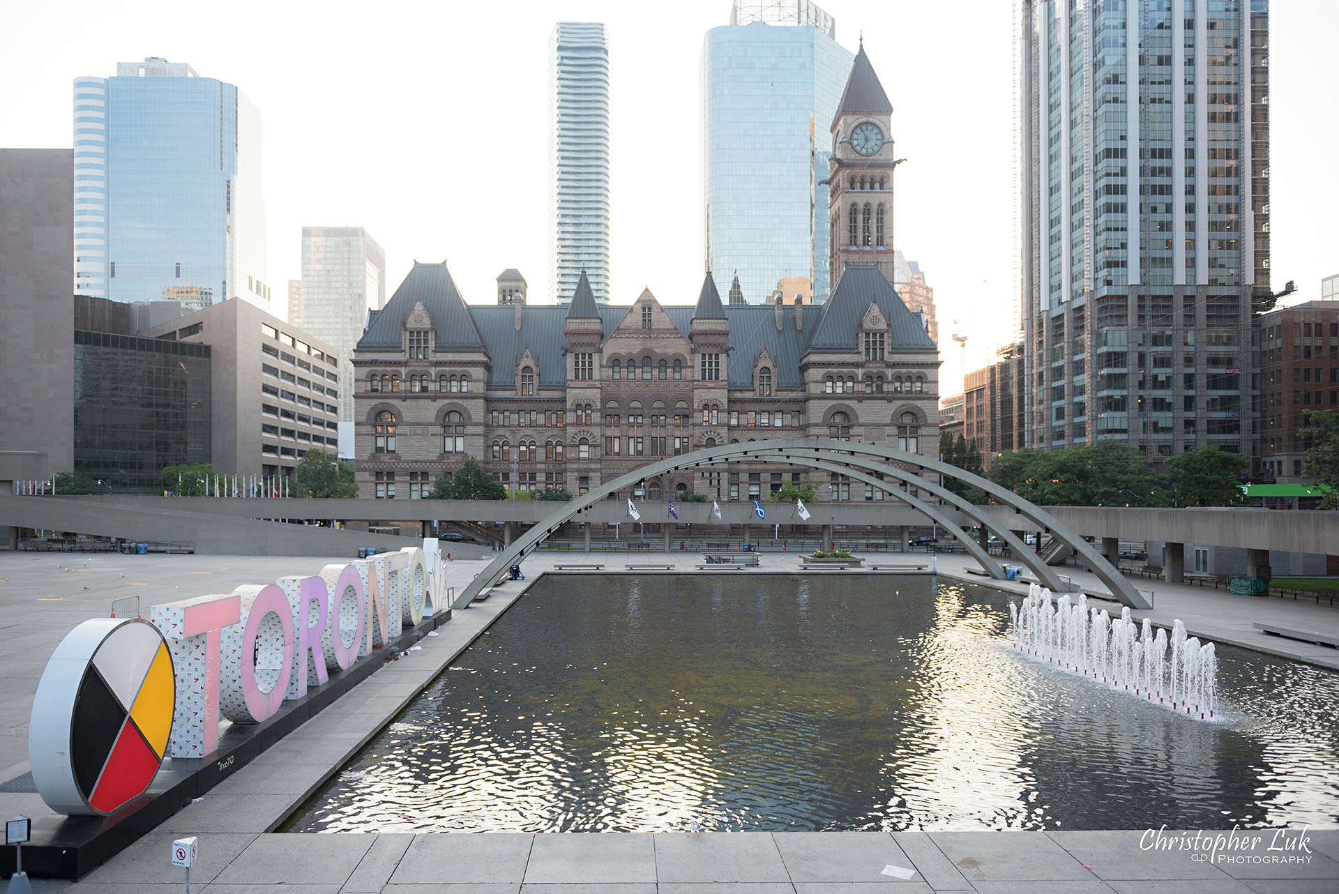 Christopher Luk Wedding Photographer Old Toronto City Hall Nathan Philips Square Elevated Bridge Arches Archway Wide Landscape Toronto 3D Sign Water Pool Fountain Feature