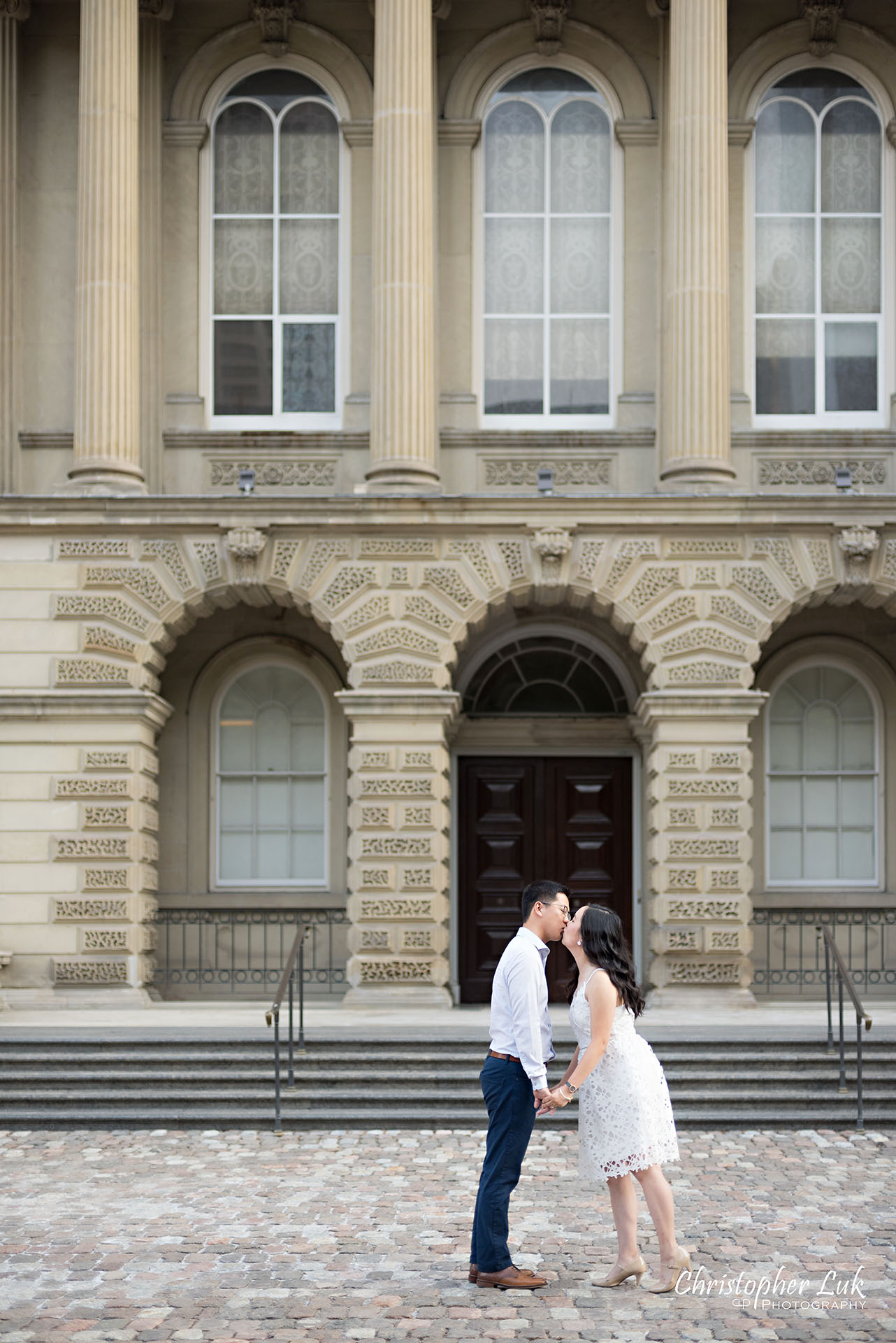 Christopher Luk Wedding Photographer Osgoode Hall Toronto Bride Groom Main Historic Building Front Cobblestone Holding Hands Walking Together Kiss Portrait Christopher Luk Wedding Photographer Osgoode Hall Toronto Bride Groom Main Historic Building Front Cobblestone Holding Hands Walking Together Looking at Each Other Portrait Natural Candid Photojournalistic