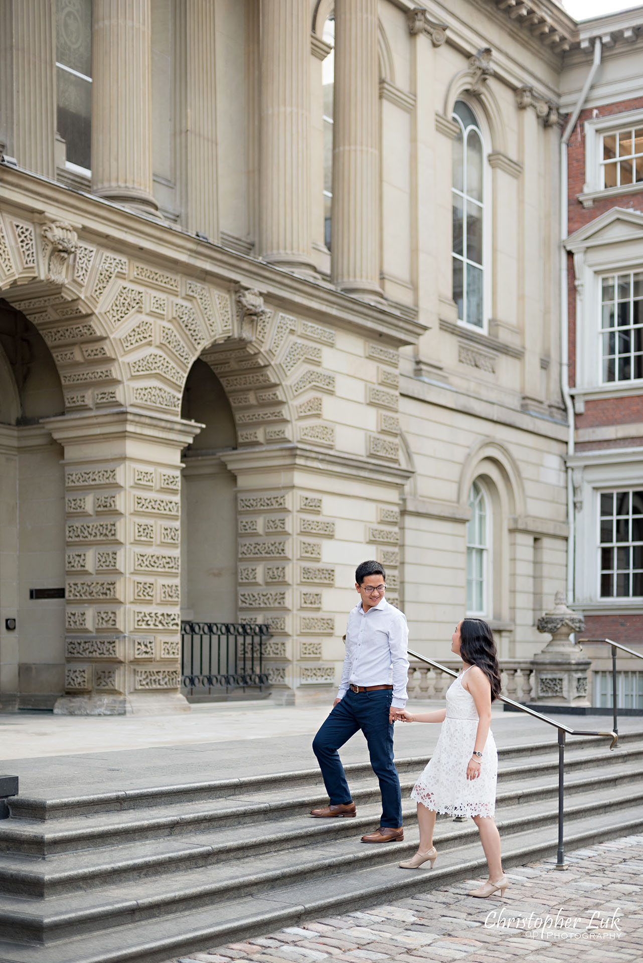 Christopher Luk Wedding Photographer Osgoode Hall Toronto Bride Groom Main Historic Building Front Cobblestone Holding Hands Walking Together Stairs Staircase Portrait Christopher Luk Wedding Photographer Osgoode Hall Toronto Bride Groom Main Historic Building Front Cobblestone Holding Hands Walking Together Looking at Each Other Portrait Natural Candid Photojournalistic