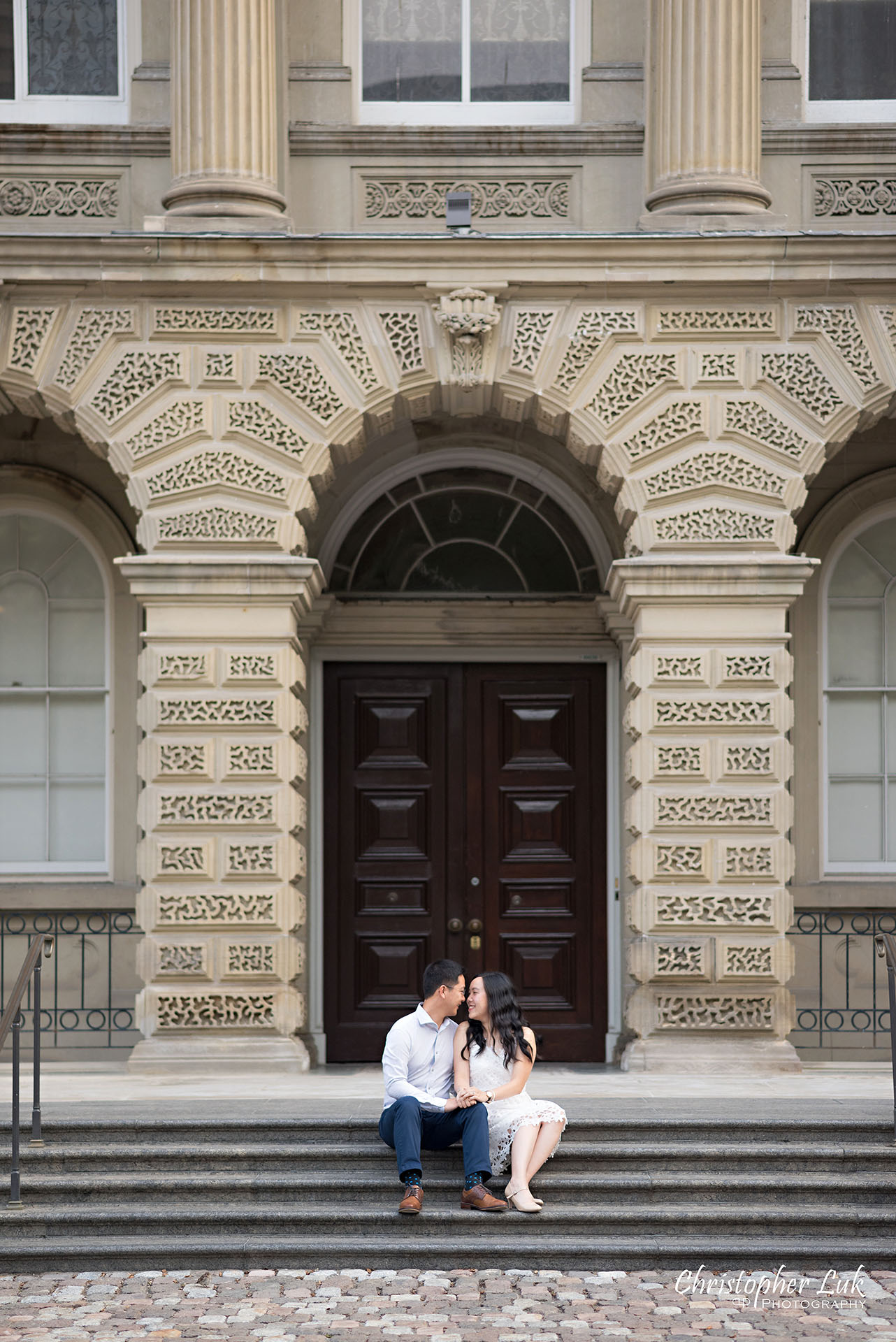 Christopher Luk Wedding Photographer Osgoode Hall Toronto Bride Groom Main Historic Building Front Steps Holding Hands Sitting Together Portrait Christopher Luk Wedding Photographer Osgoode Hall Toronto Bride Groom Main Historic Building Front Cobblestone Holding Hands Walking Together Looking at Each Other Portrait Natural Candid Photojournalistic