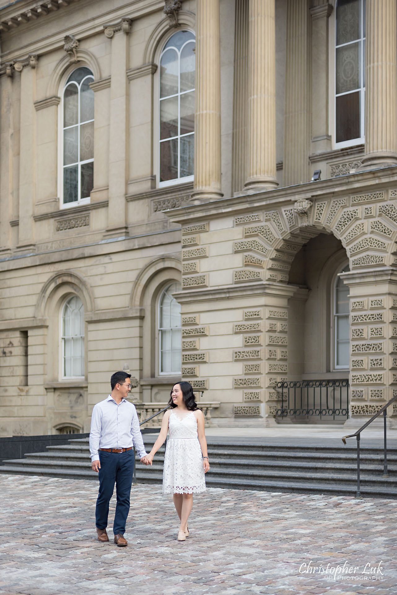 Christopher Luk Wedding Photographer Osgoode Hall Toronto Bride Groom Main Historic Building Front Cobblestone Holding Hands Walking Together Portrait Christopher Luk Wedding Photographer Osgoode Hall Toronto Bride Groom Main Historic Building Front Cobblestone Holding Hands Walking Together Looking at Each Other Portrait Natural Candid Photojournalistic