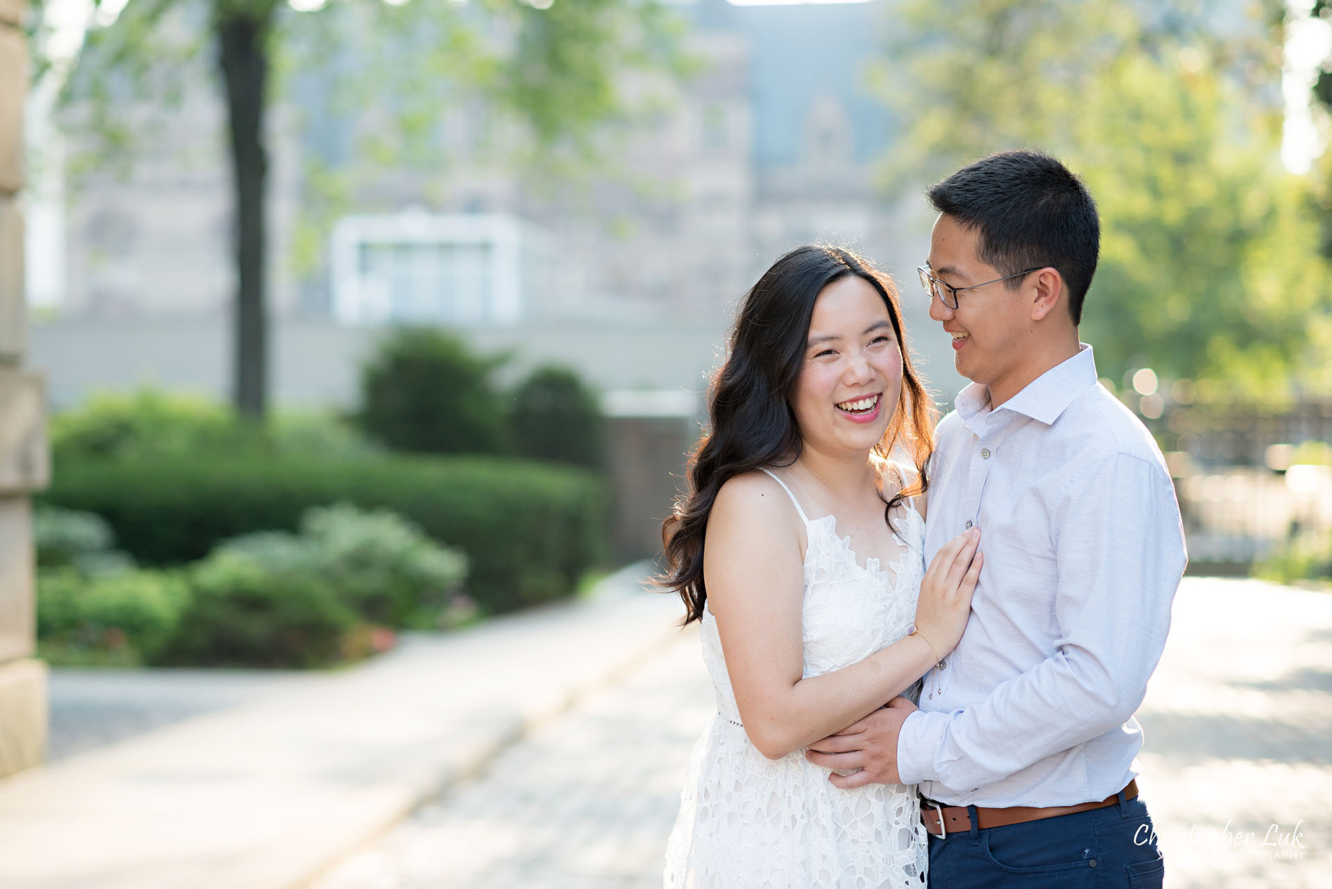 Christopher Luk Wedding Photographer Osgoode Hall Toronto Bride Groom Cobblestone Hug Holding Each Other Intimate Snuggle Laugh Natural Candid Photojournalistic