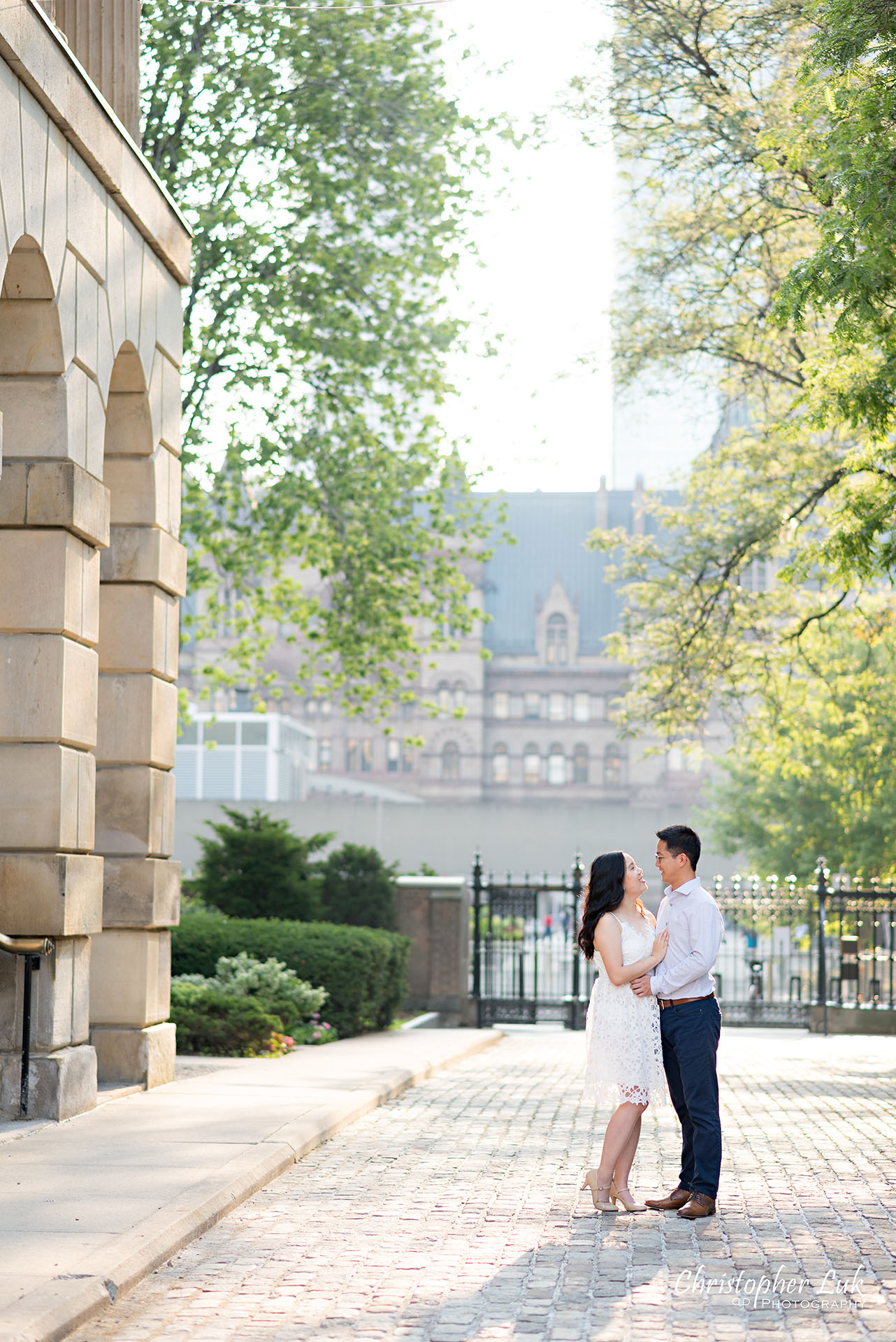 Christopher Luk Wedding Photographer Osgoode Hall Toronto Bride Groom Cobblestone Hug Holding Each Other Intimate Snuggle Portrait Natural Candid Photojournalistic