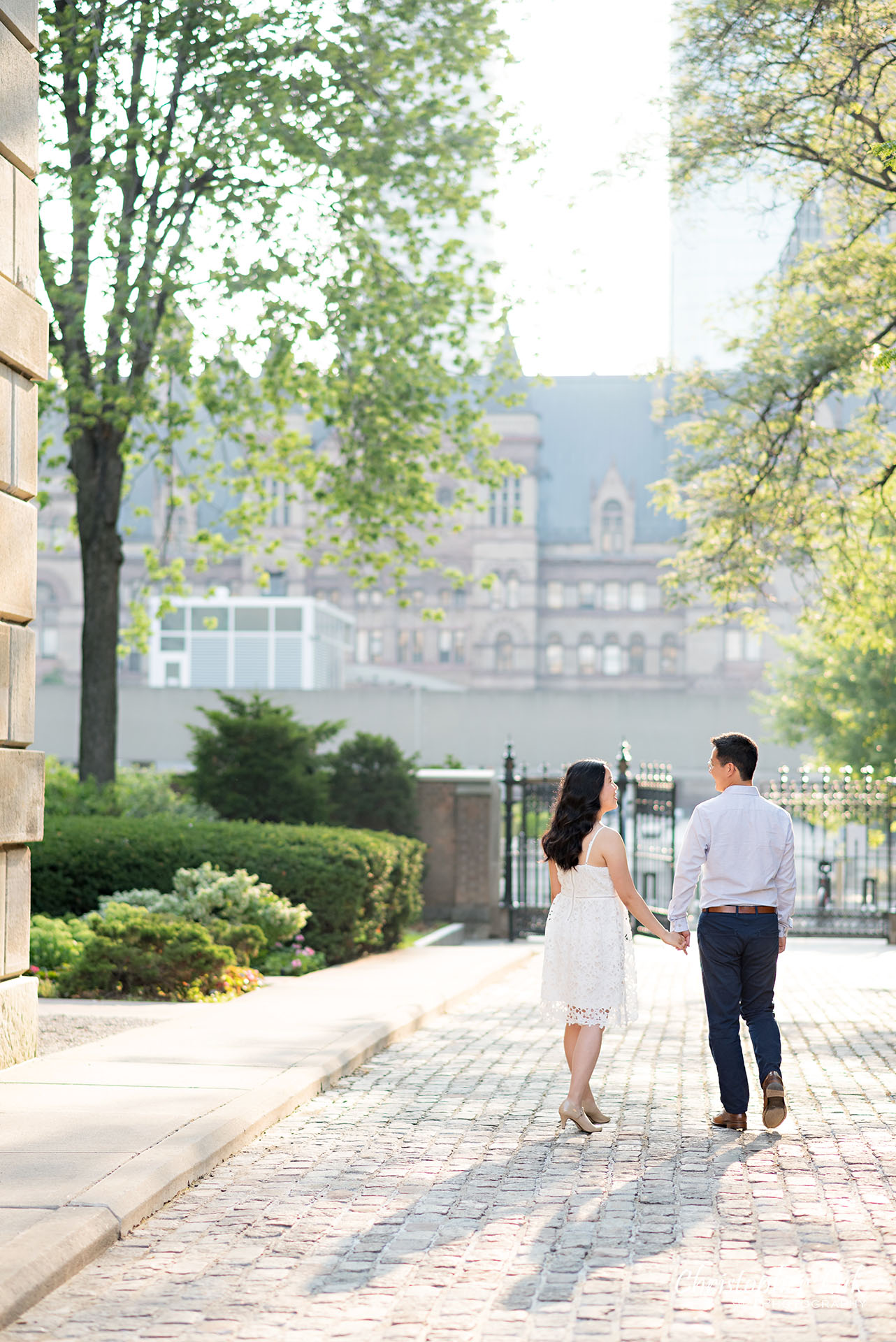 Christopher Luk Wedding Photographer Osgoode Hall Toronto Bride Groom Cobblestone Hug Holding Each Other Intimate Holding Hands Walking Together Sunrise Shadow Portrait Natural Candid Photojournalistic