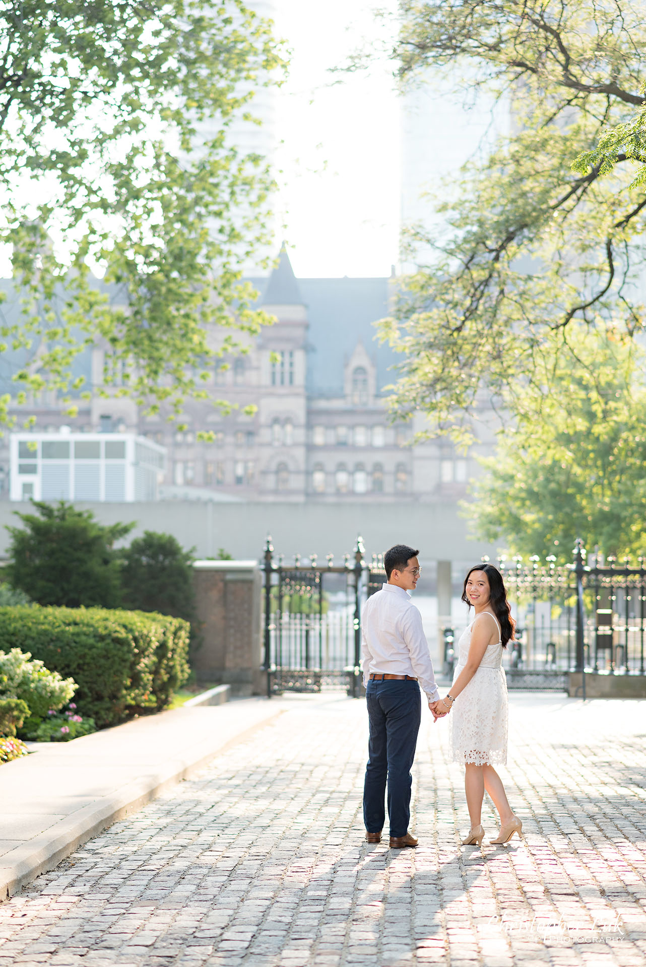 Christopher Luk Wedding Photographer Osgoode Hall Toronto Bride Groom Cobblestone Hug Holding Each Other Intimate Holding Hands Walking Together Sunrise Shadow Turn Around Smile Portrait Natural Candid Photojournalistic