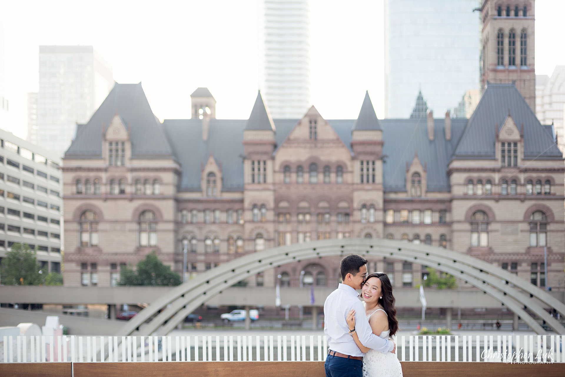 Christopher Luk Wedding Photographer Toronto City Hall Nathan Philips Square Elevated Bridge Arches Archway Bride Groom Hug Holding Each Other Intimate Natural Candid Photojournalistic Wide Landscape